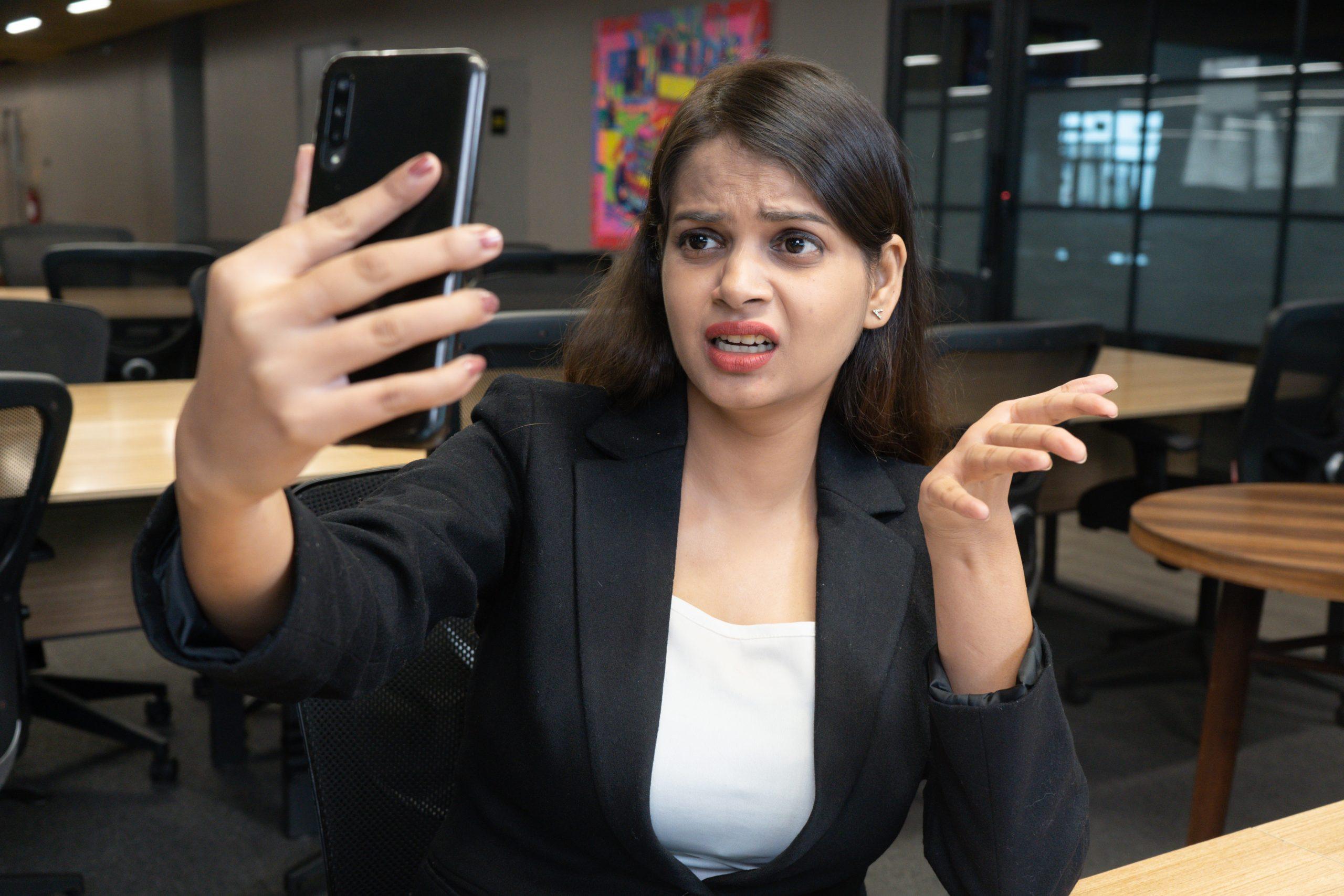 Annoyed girl taking selfie