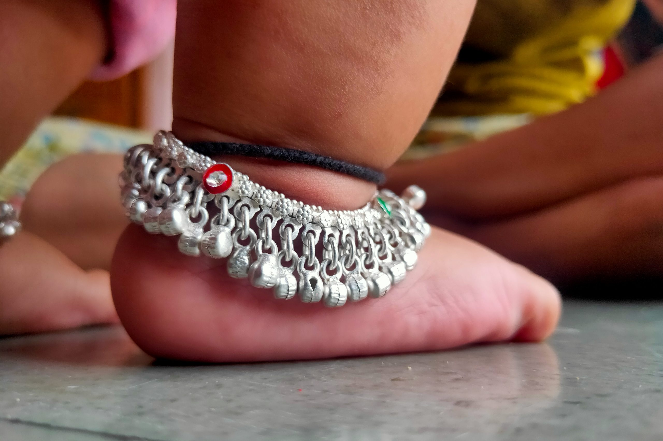 Baby wearing anklets