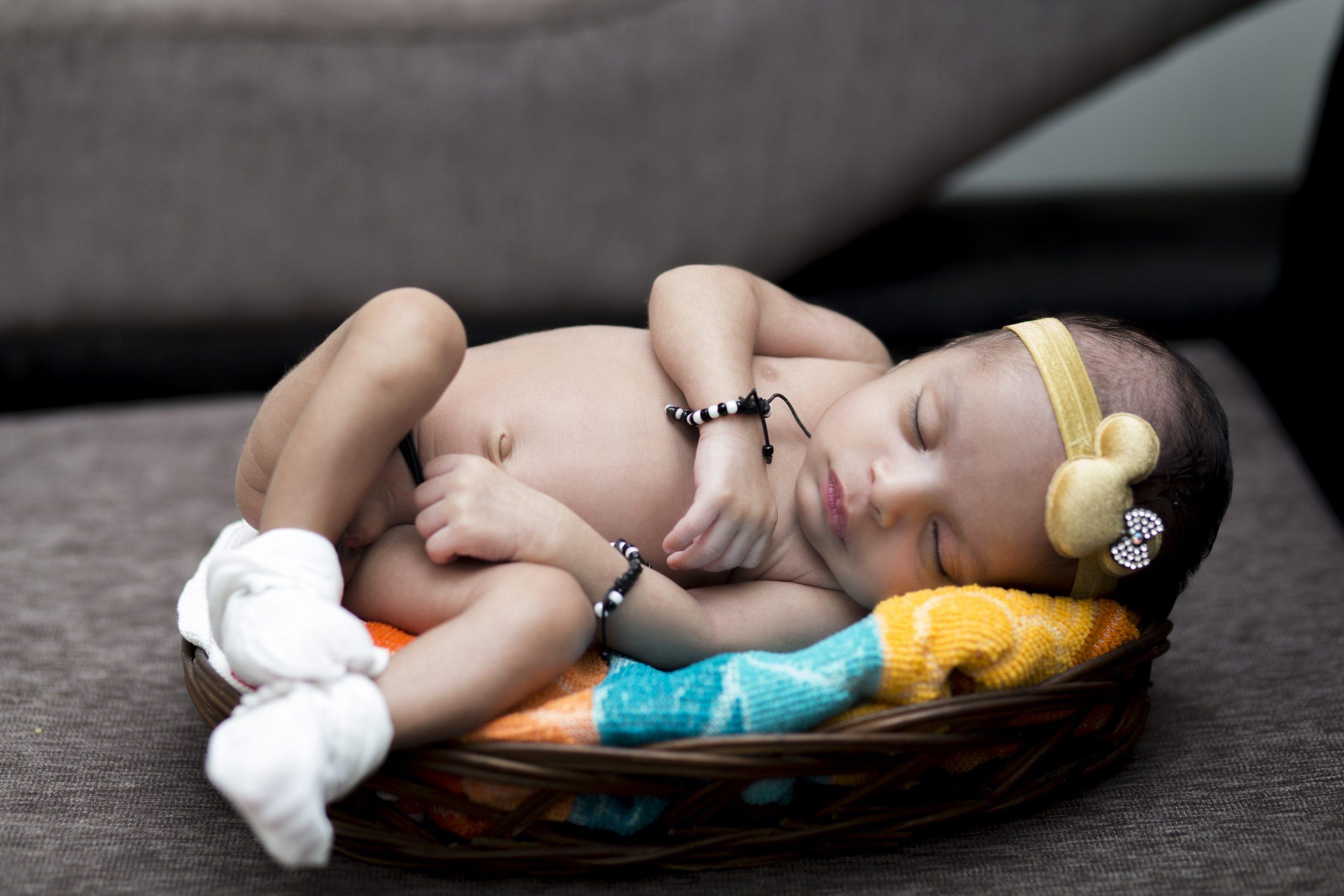 baby sleeping in a basket