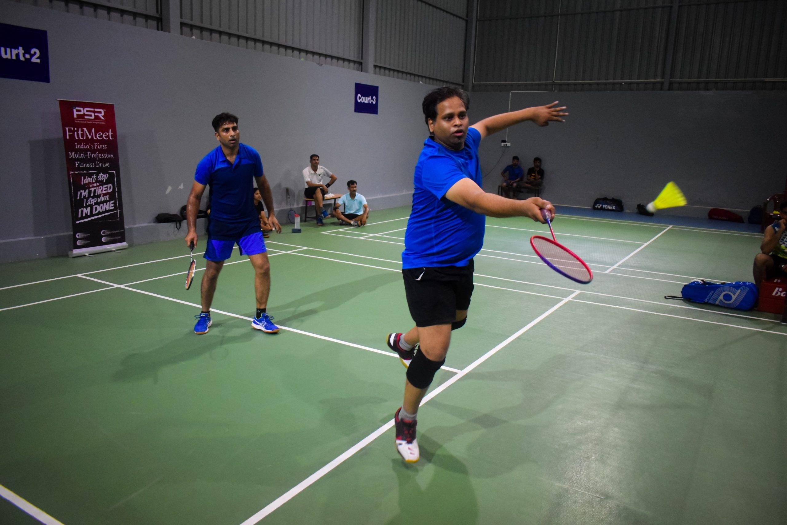 People playing badminton.