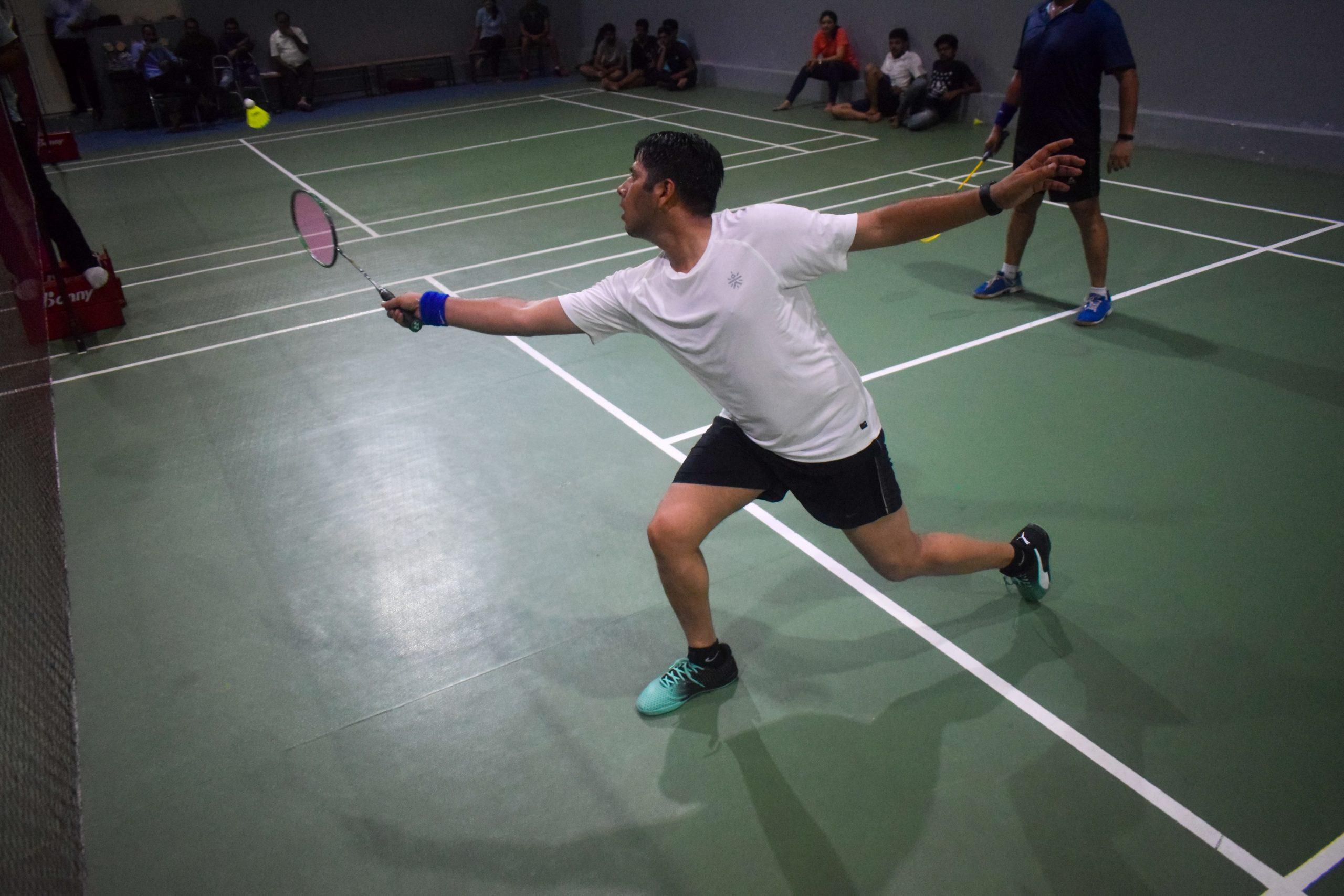 A man playing badminton.