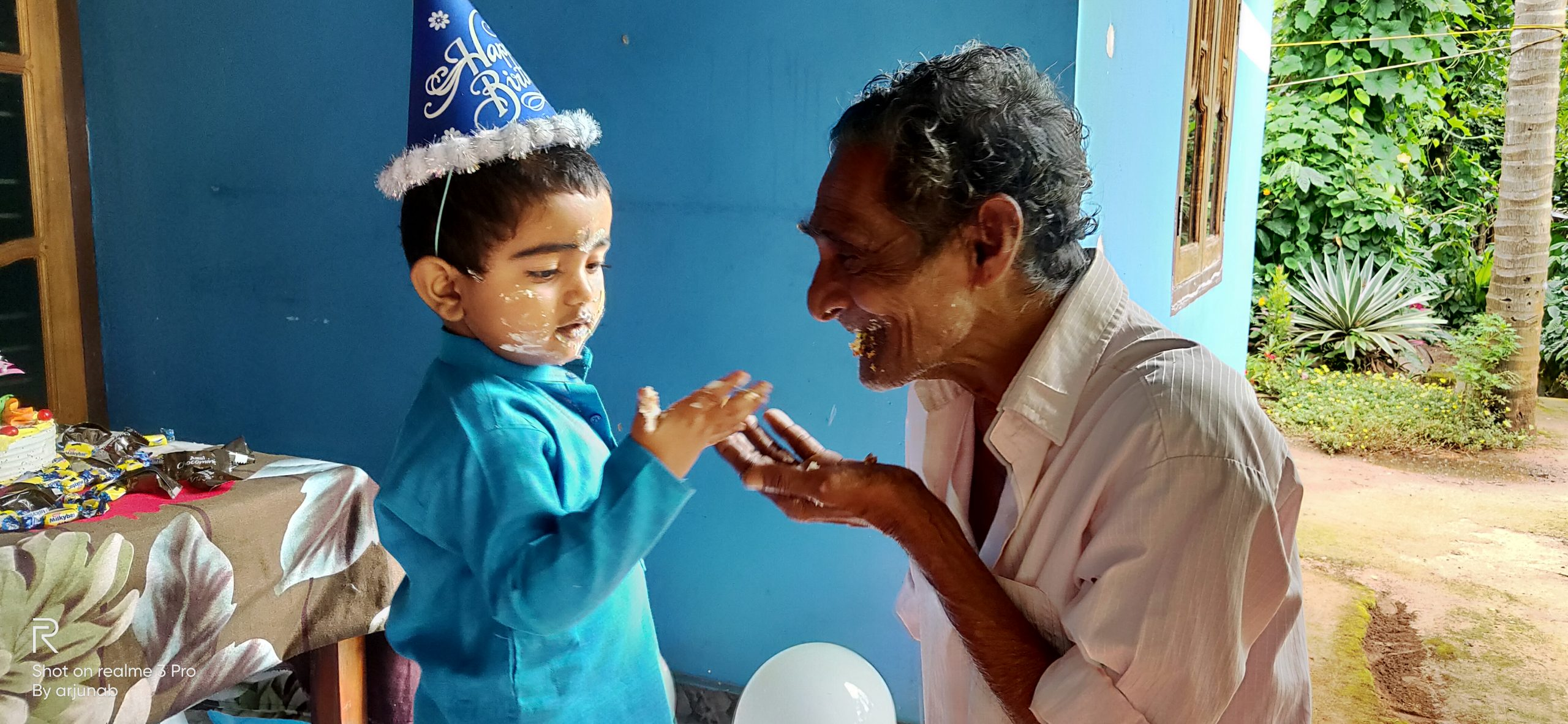 A birthday boy with his grandfather