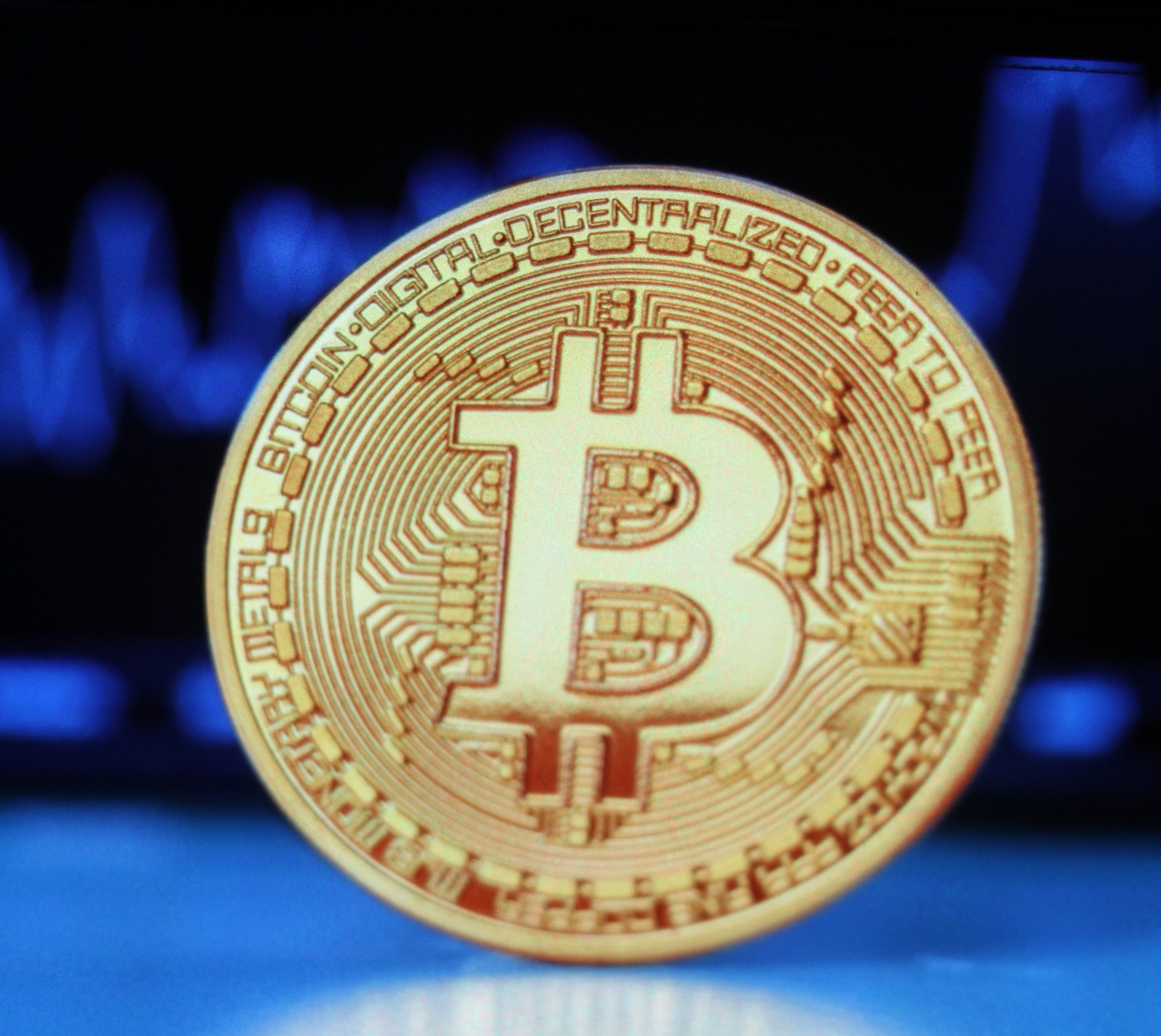 A bitcoin on blue background.