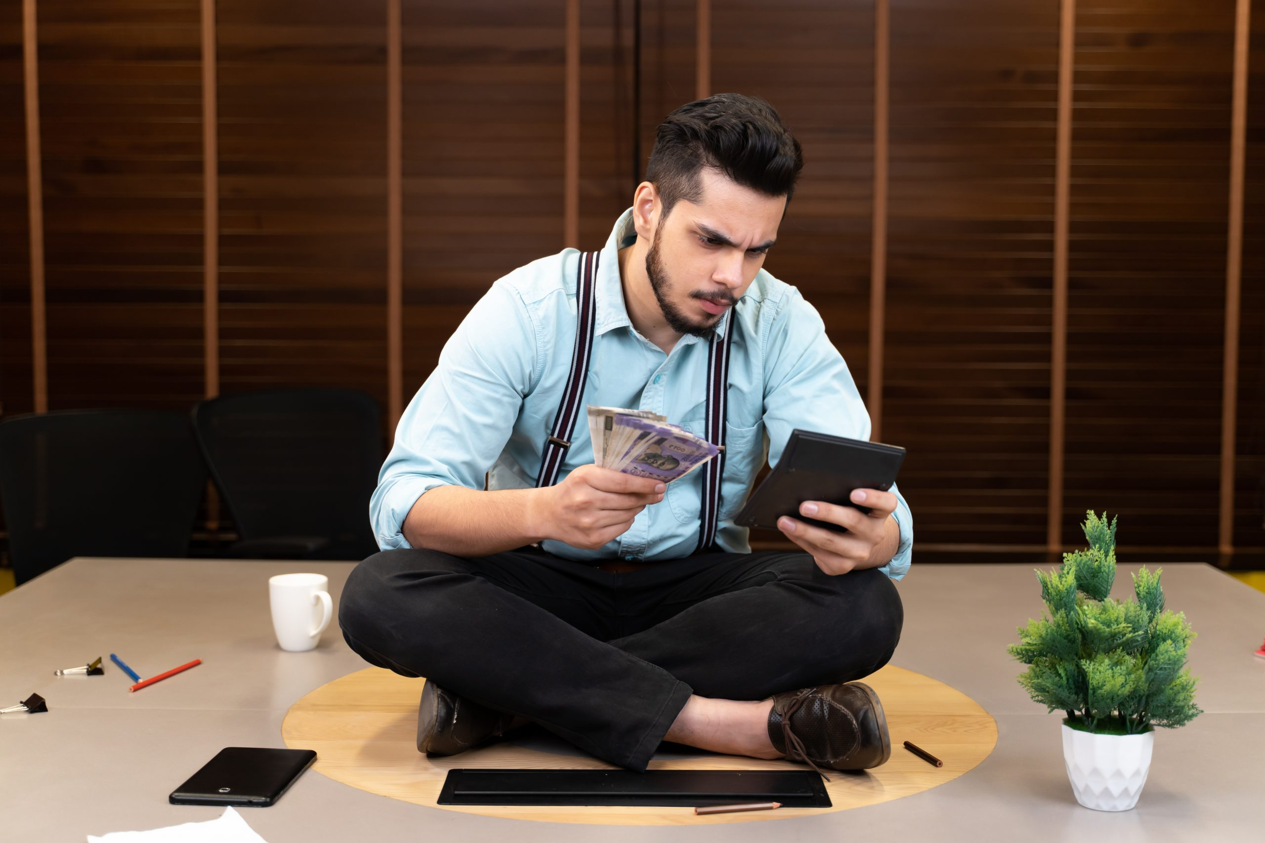 A man counting money and accounting.