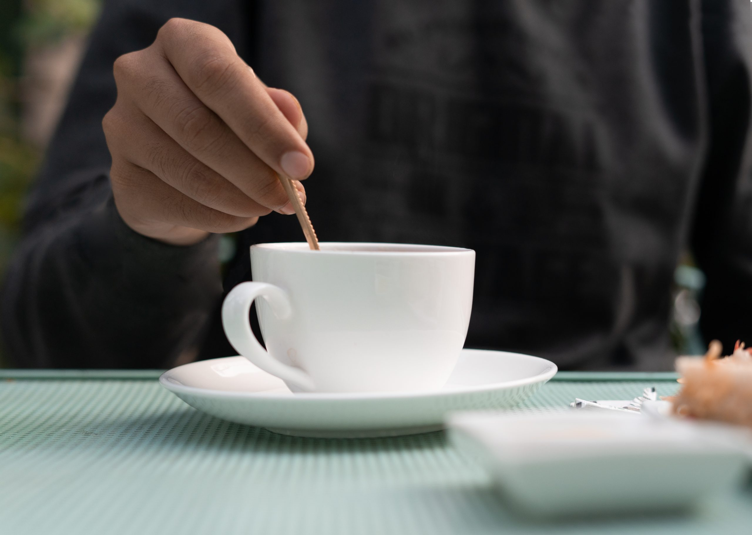 Boy mixing sugar in tea