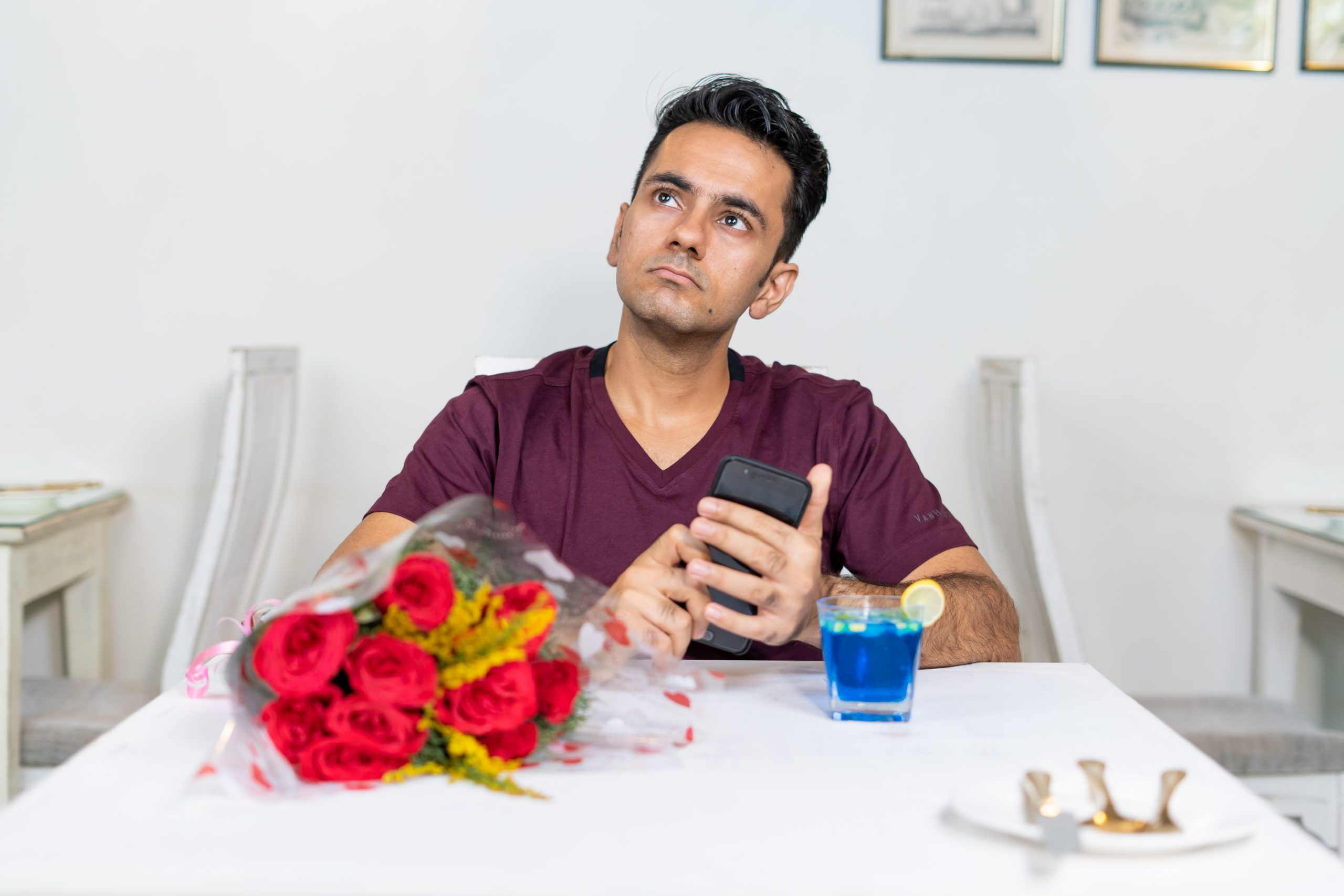 Boy waiting for his girlfriend in restaurant