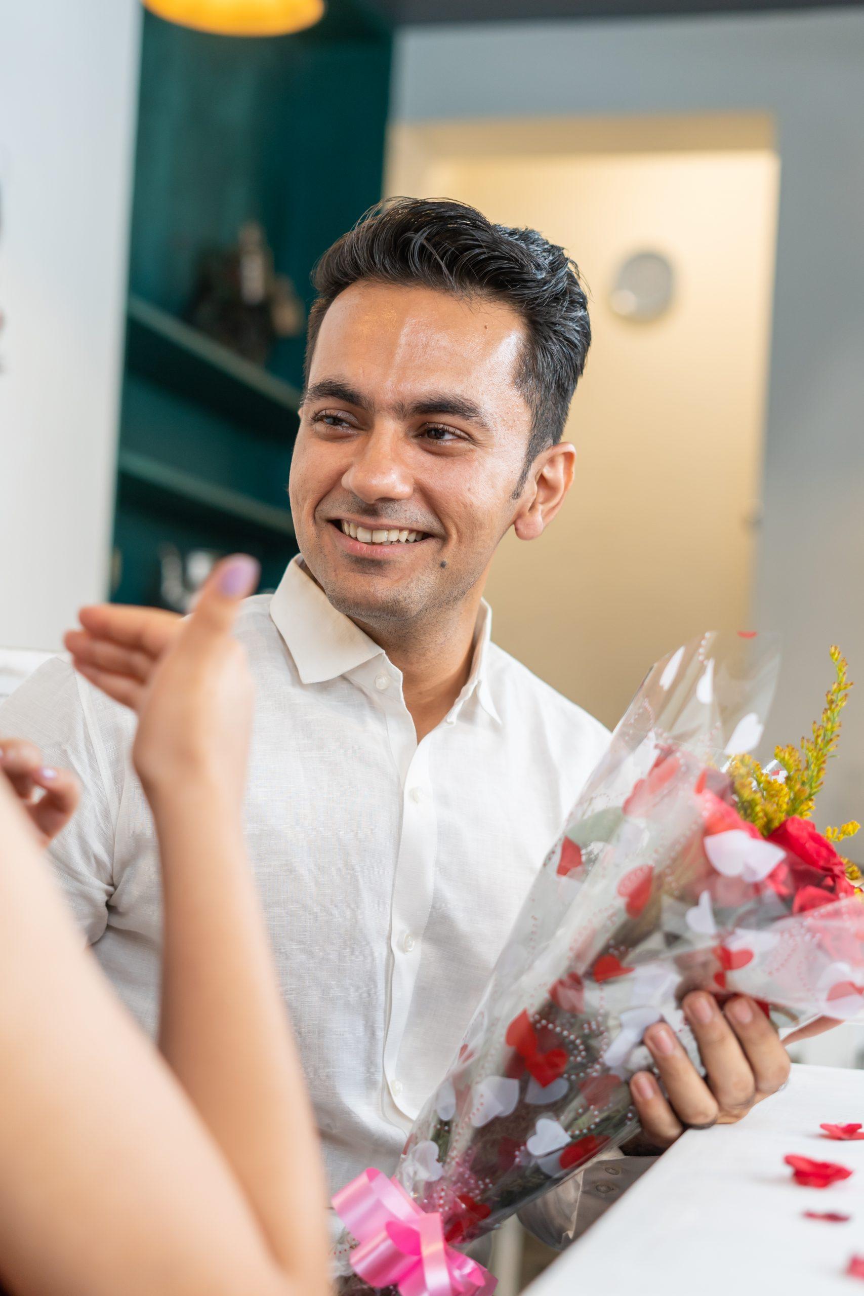 Boyfriend gifting flowers