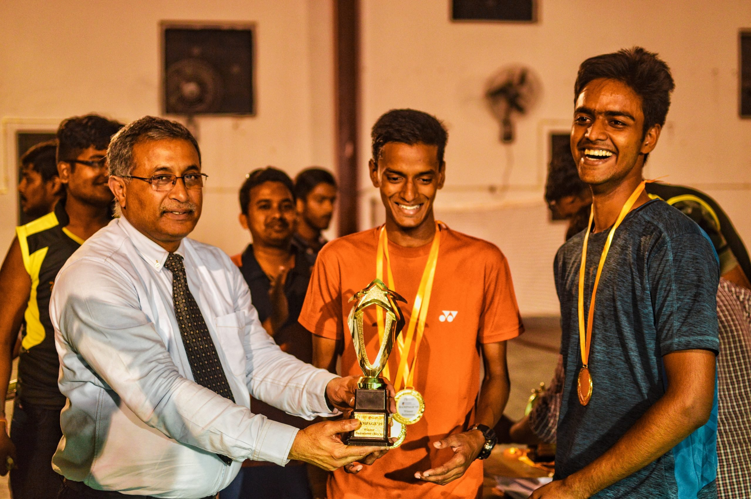 Boys receiving trophy from chief guest