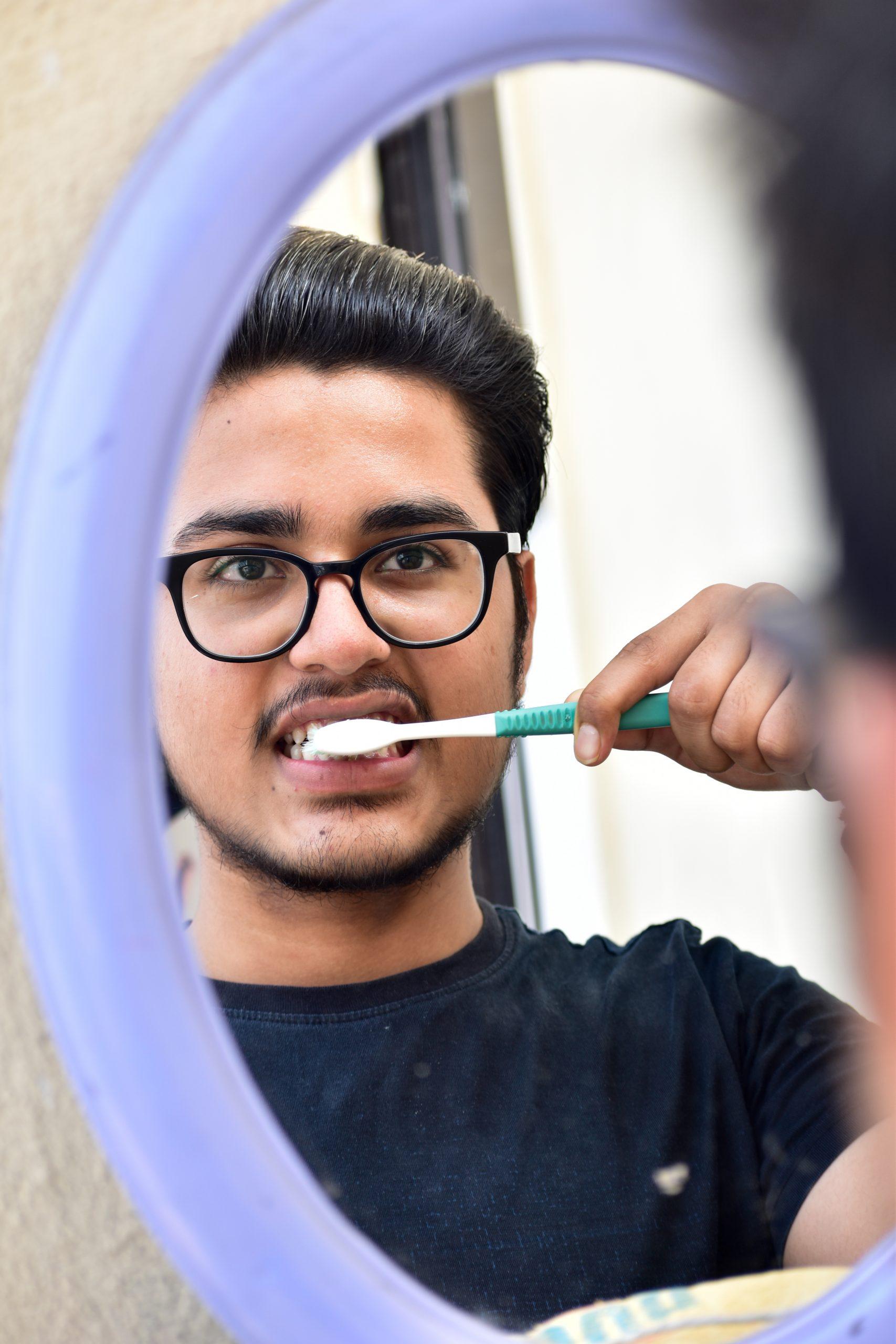 Brushing Teeth in front of mirror