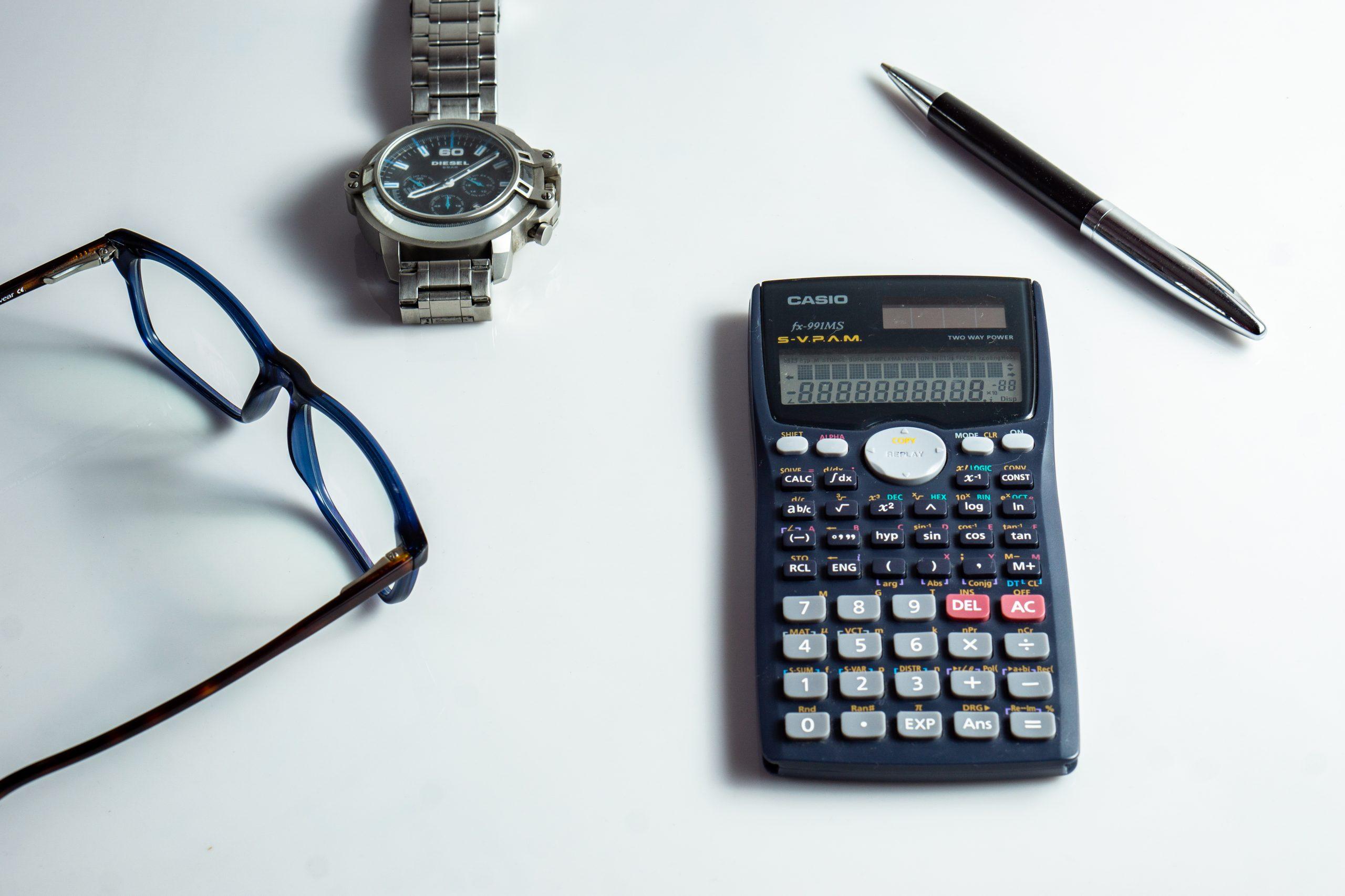Calculator, specs, pen, watch