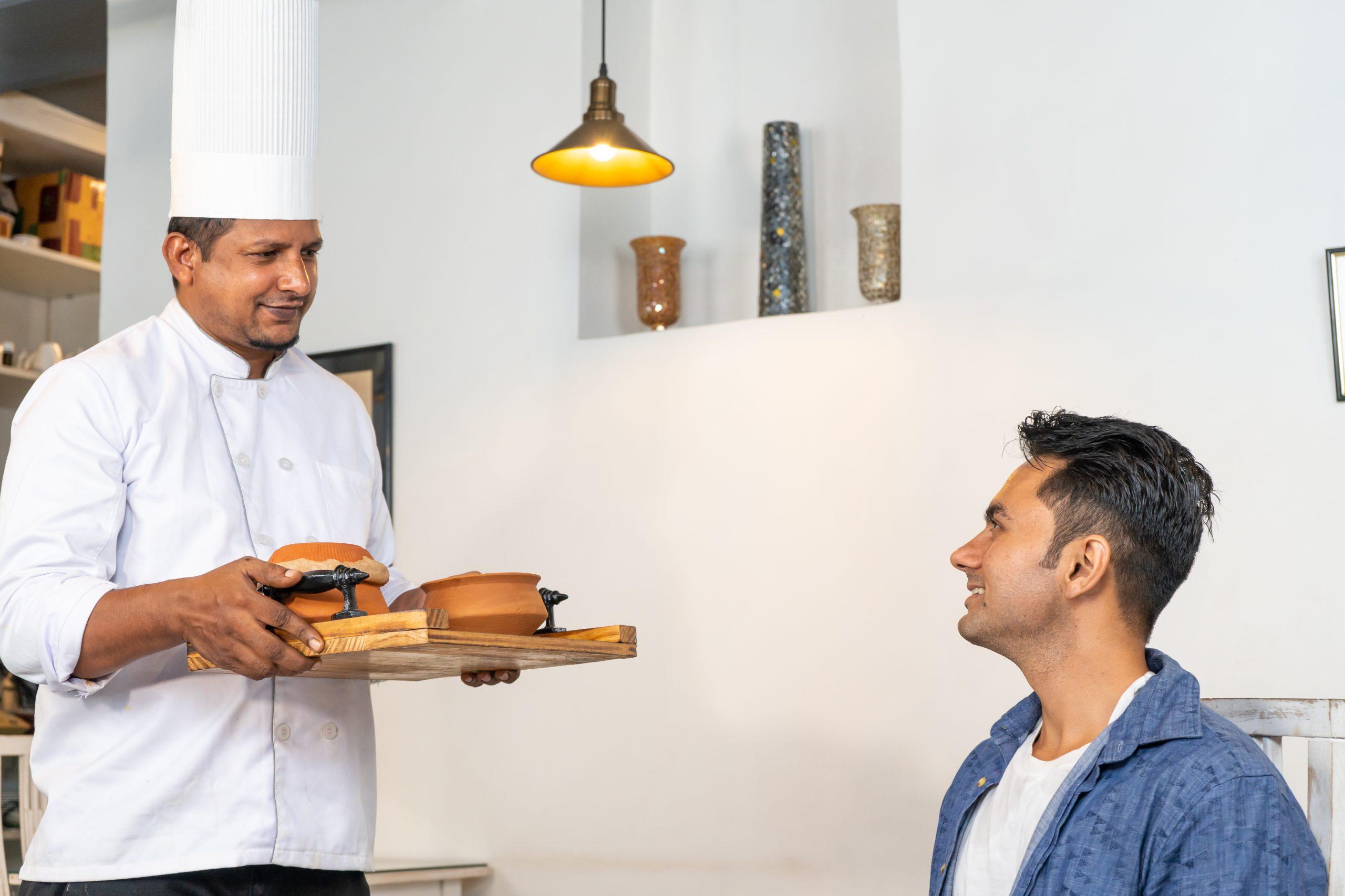 Chef bringing food