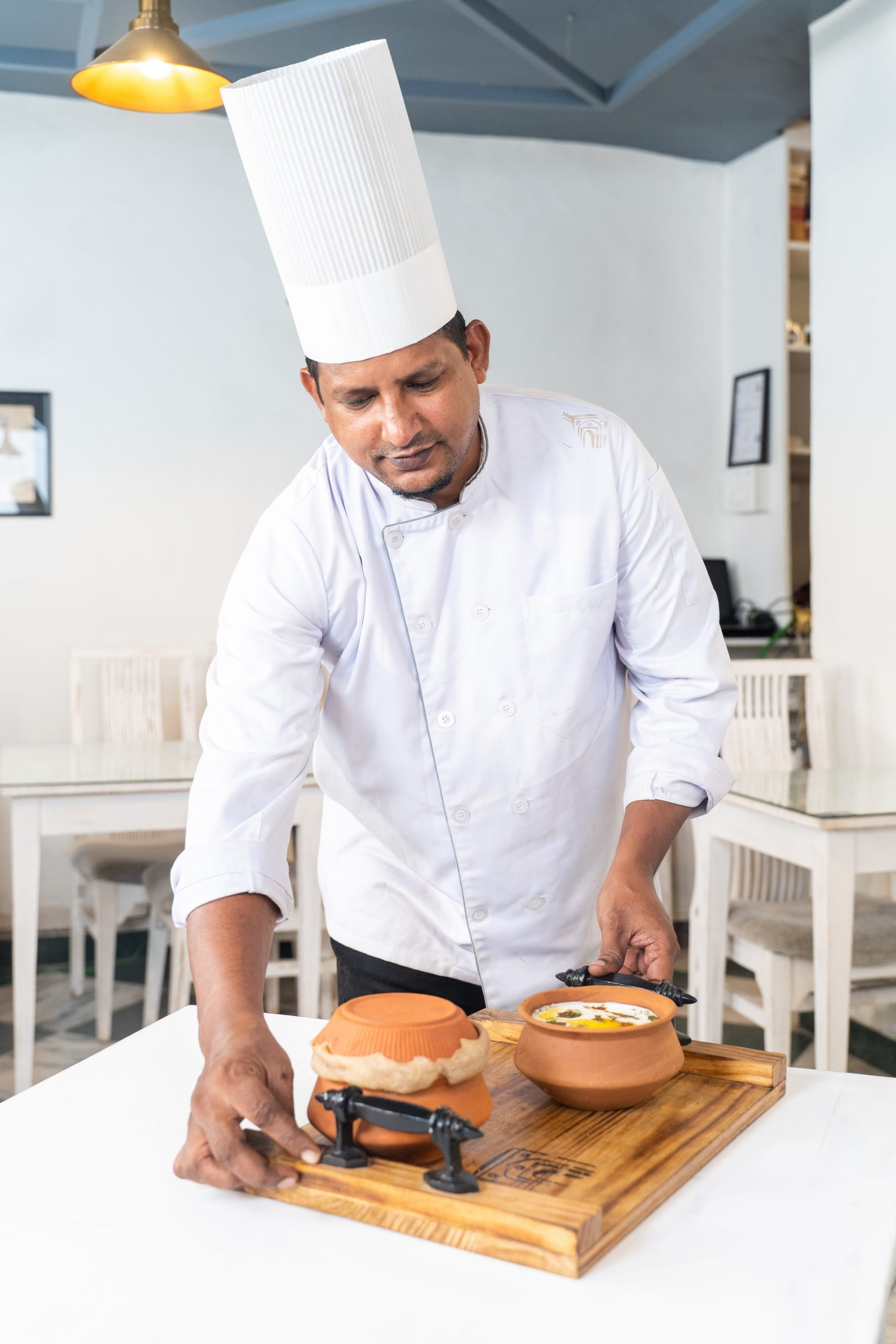 Chef serving food in restaurant