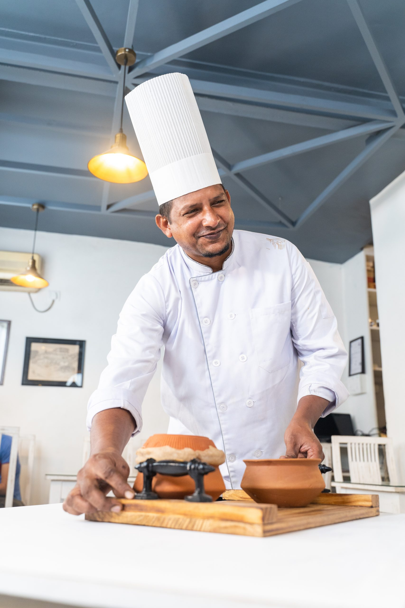 Chef smiling while offering food