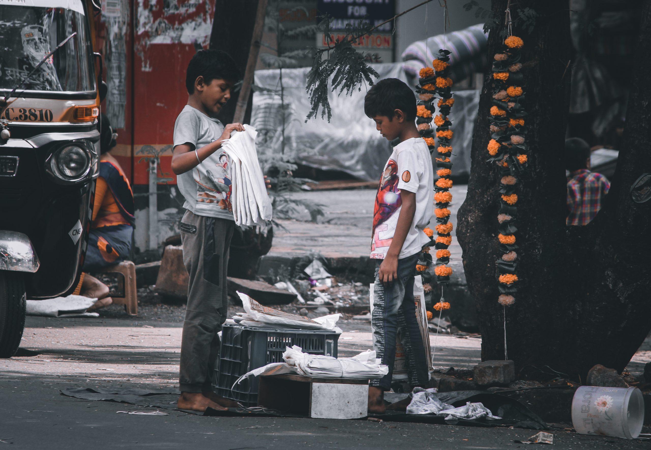 Children working beside a road
