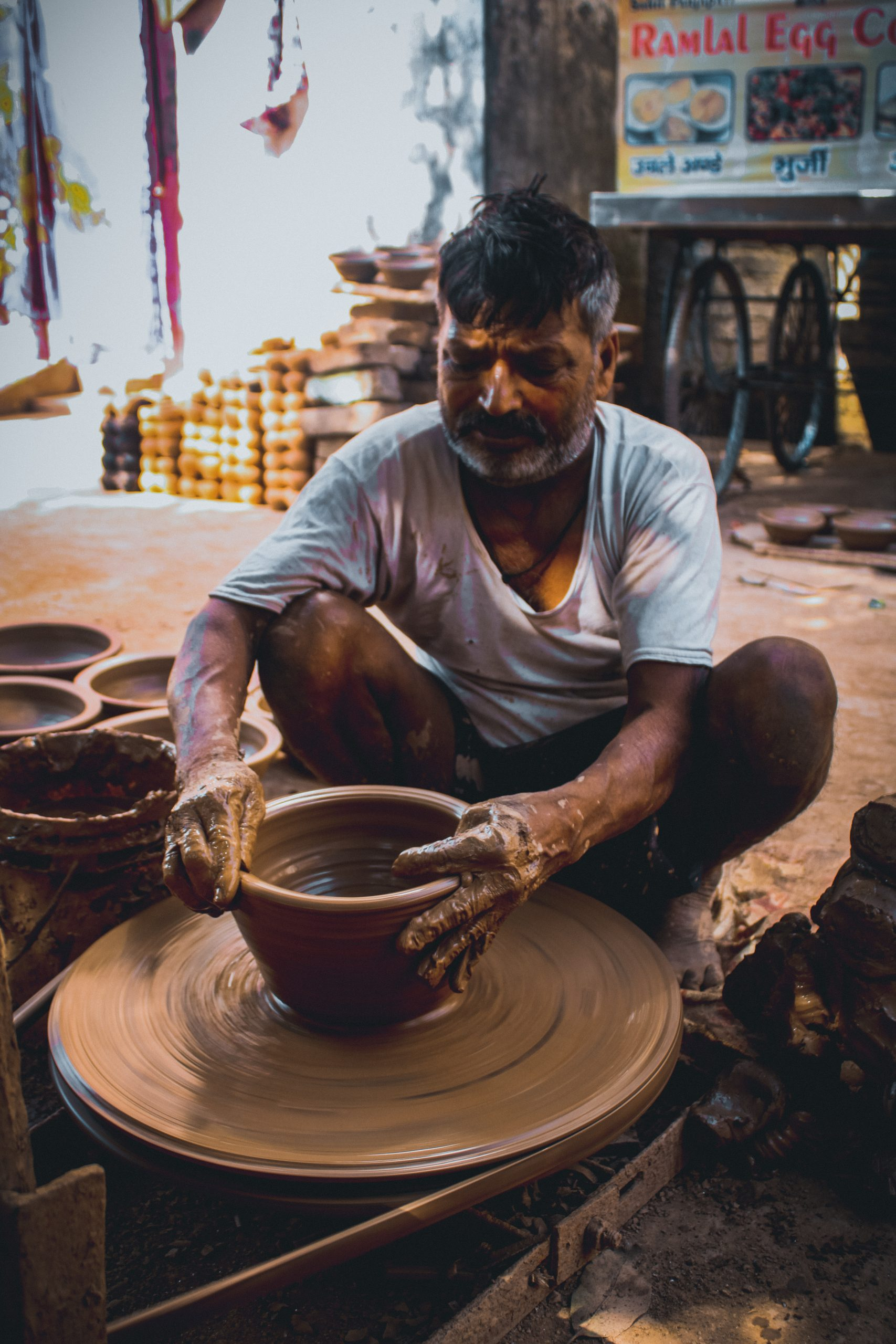 Clay pottery by a worker