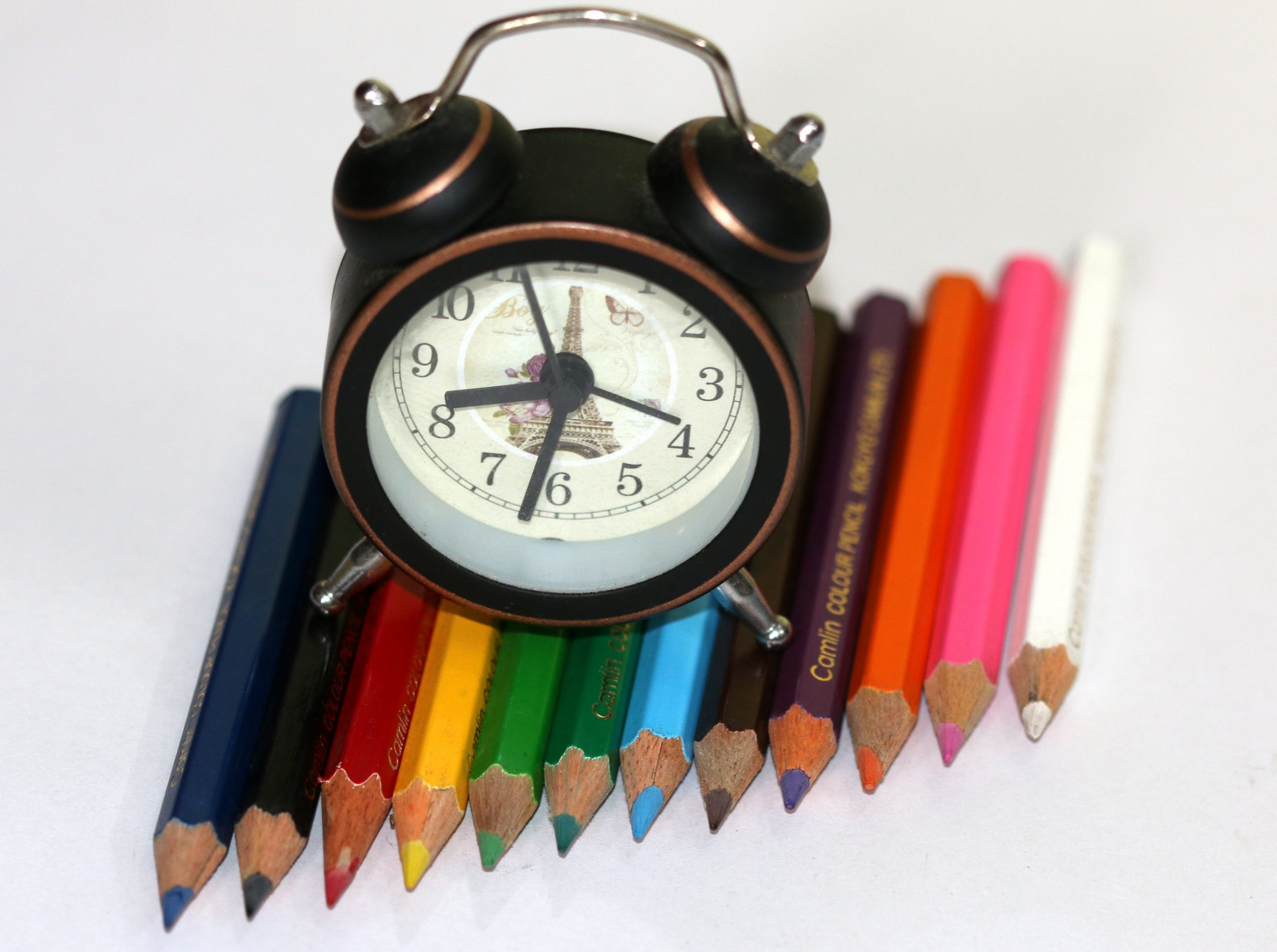 Colorful pencil and clock
