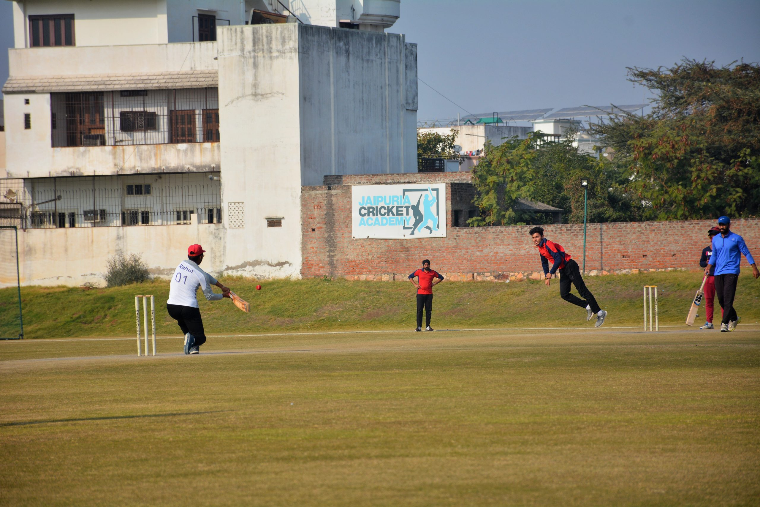boys playing cricket in the ground