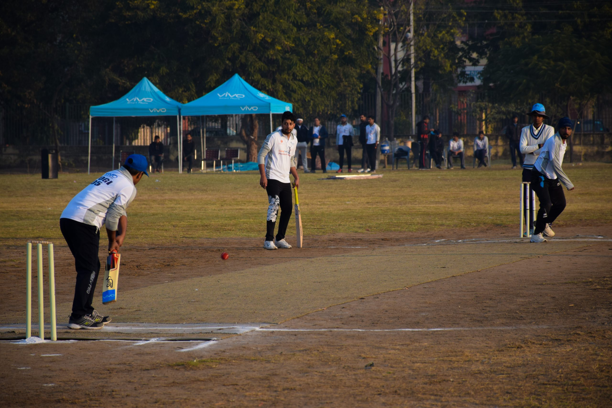 Boys playing cricket in a ground