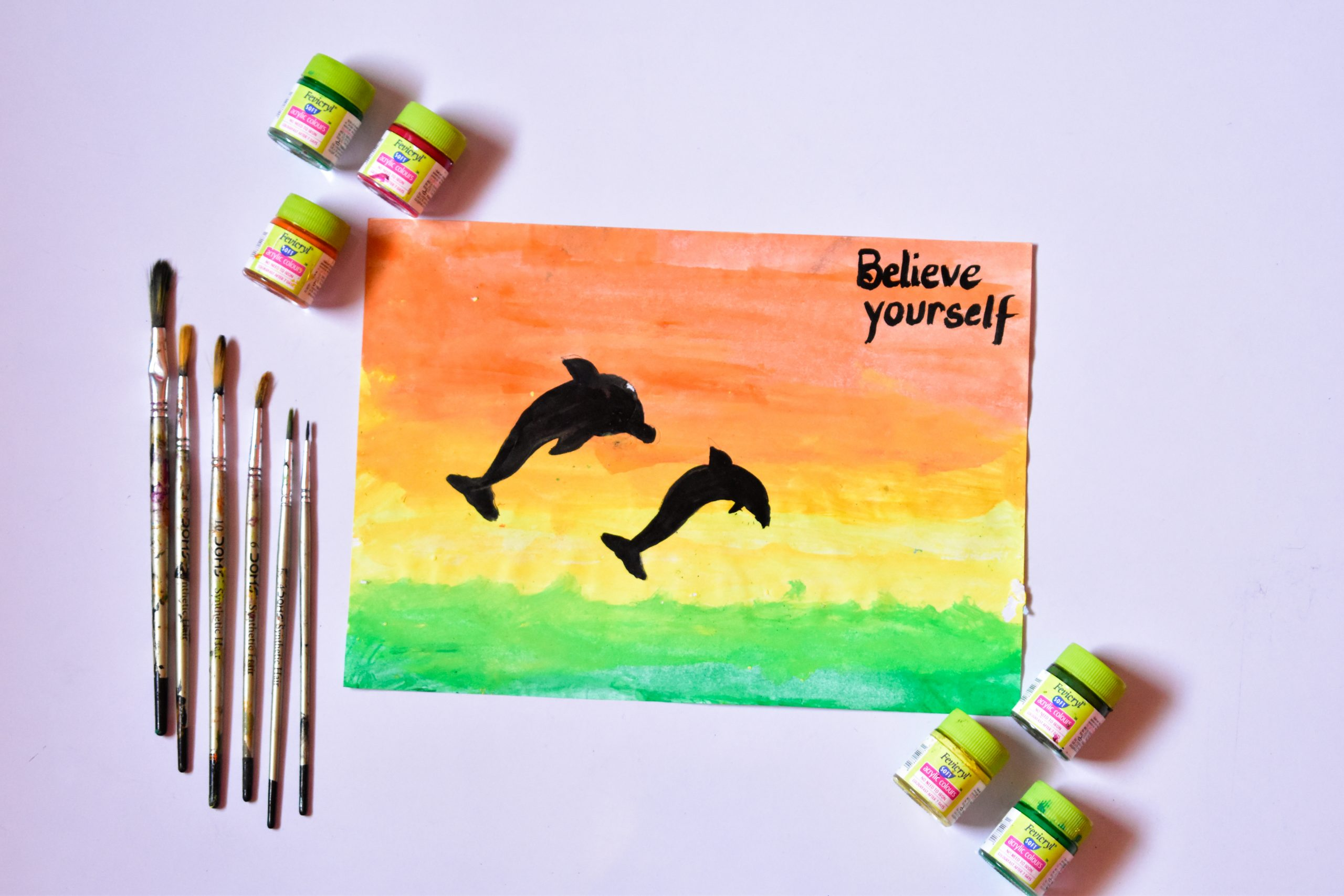 dolphin painting, paint brushes and paints