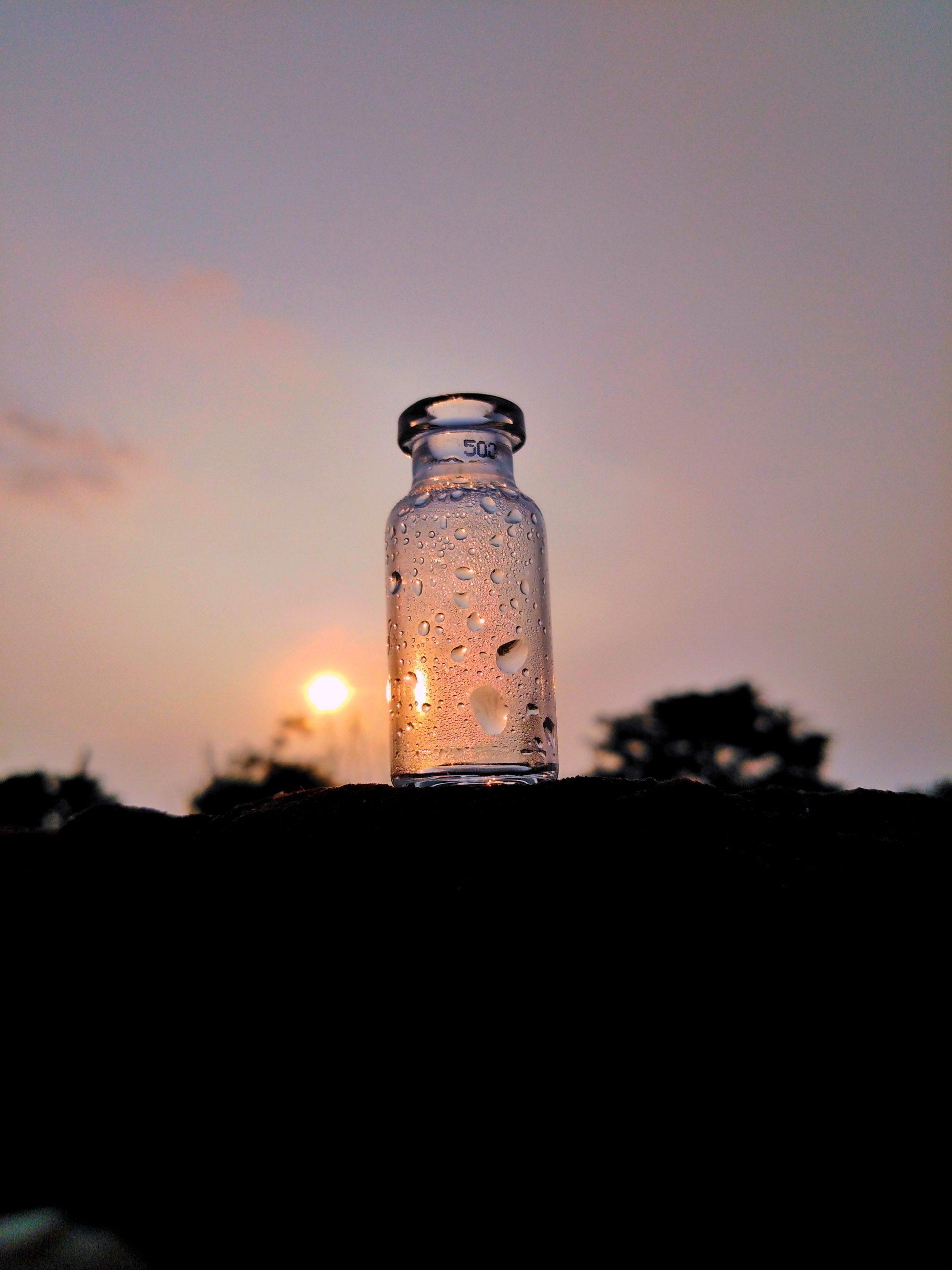drops on bottle against sunlight