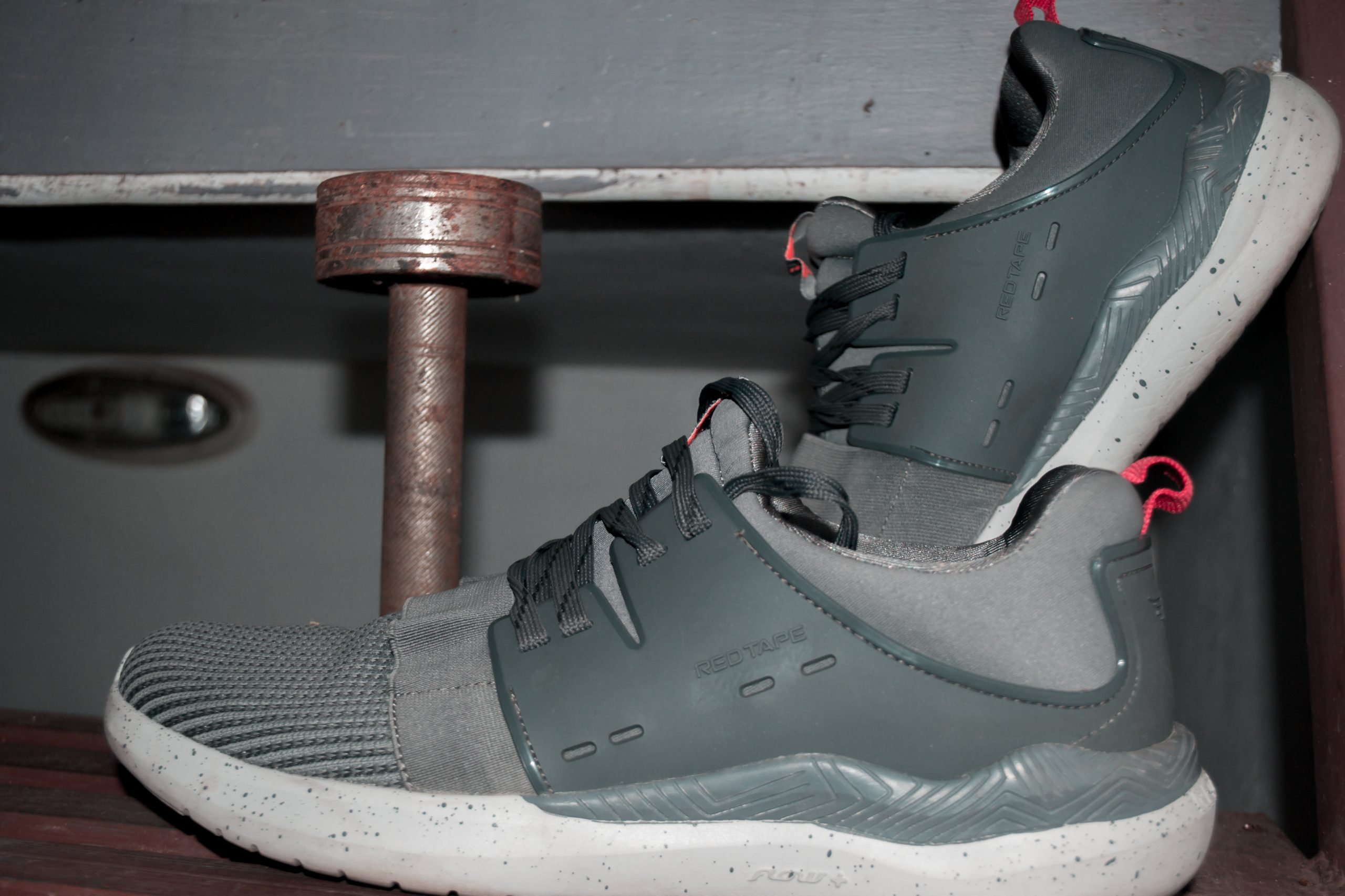 Dumbbell and gym shoes