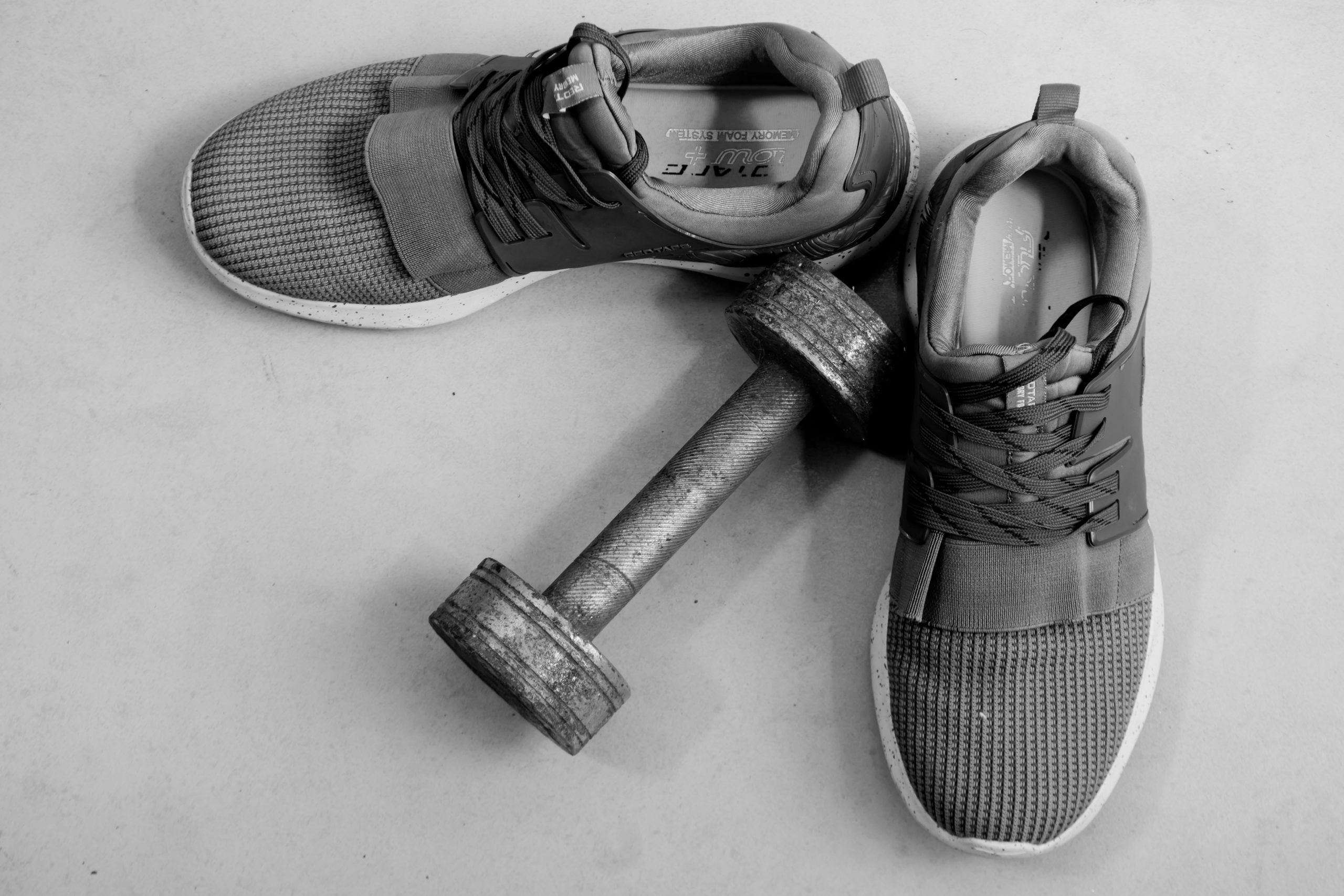Dumbbell and workout shoes
