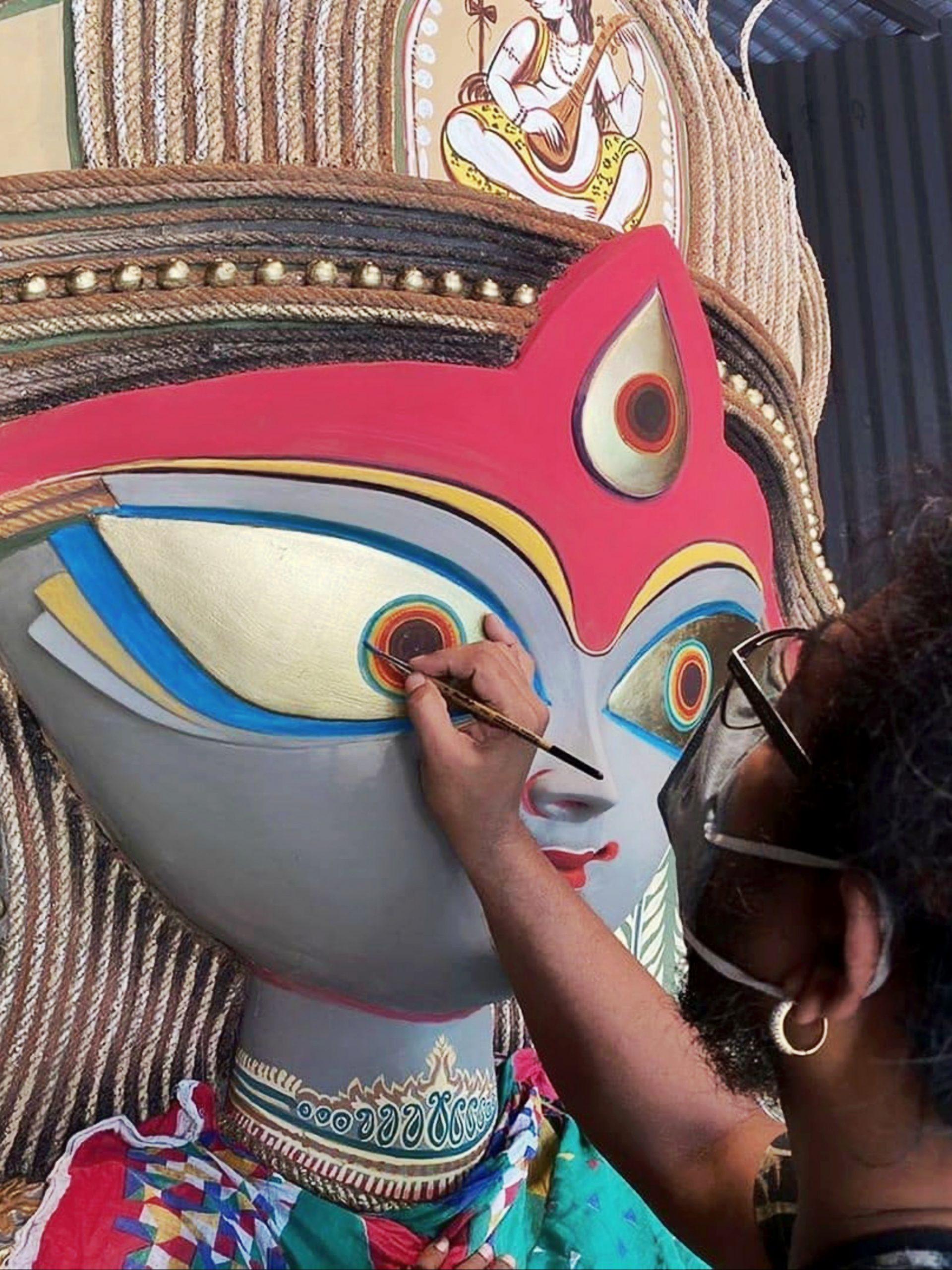 artist painting durga statue