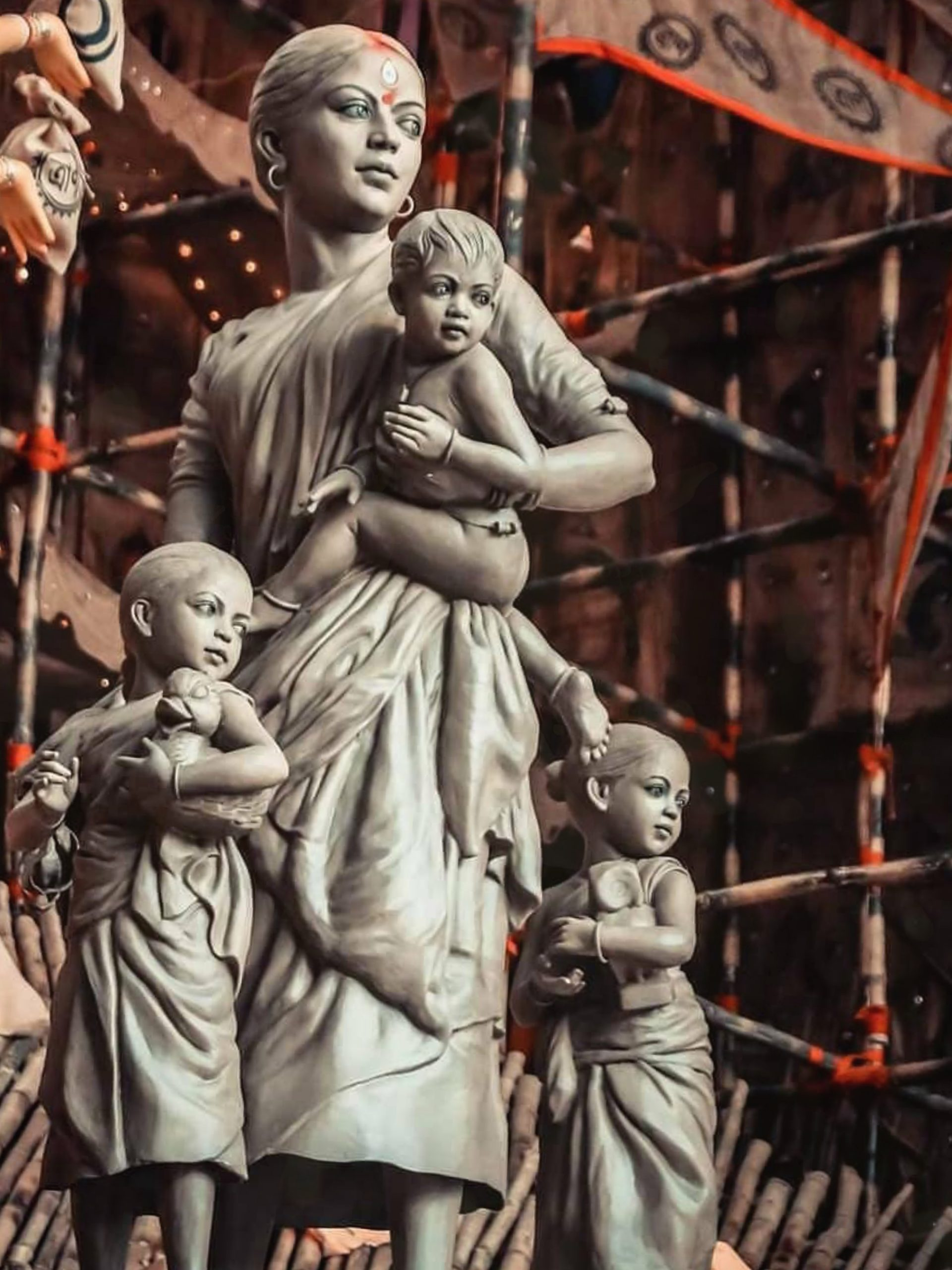Statues of a woman and children