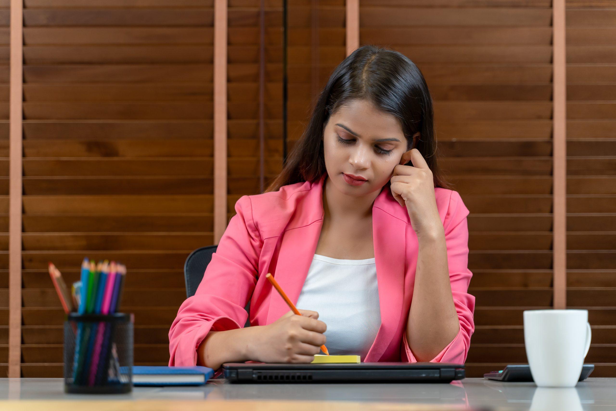 Employee taking notes during meeting