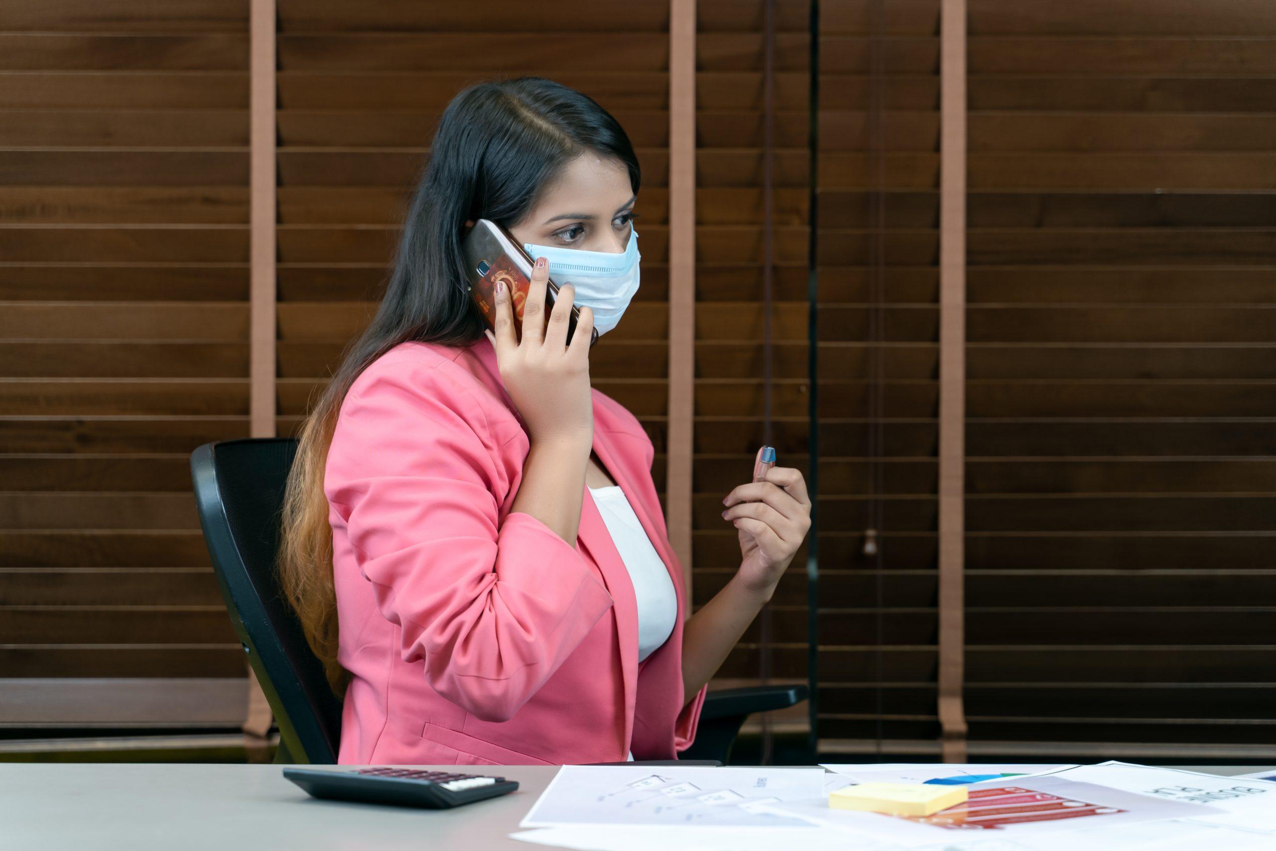 Employee talking on call in office