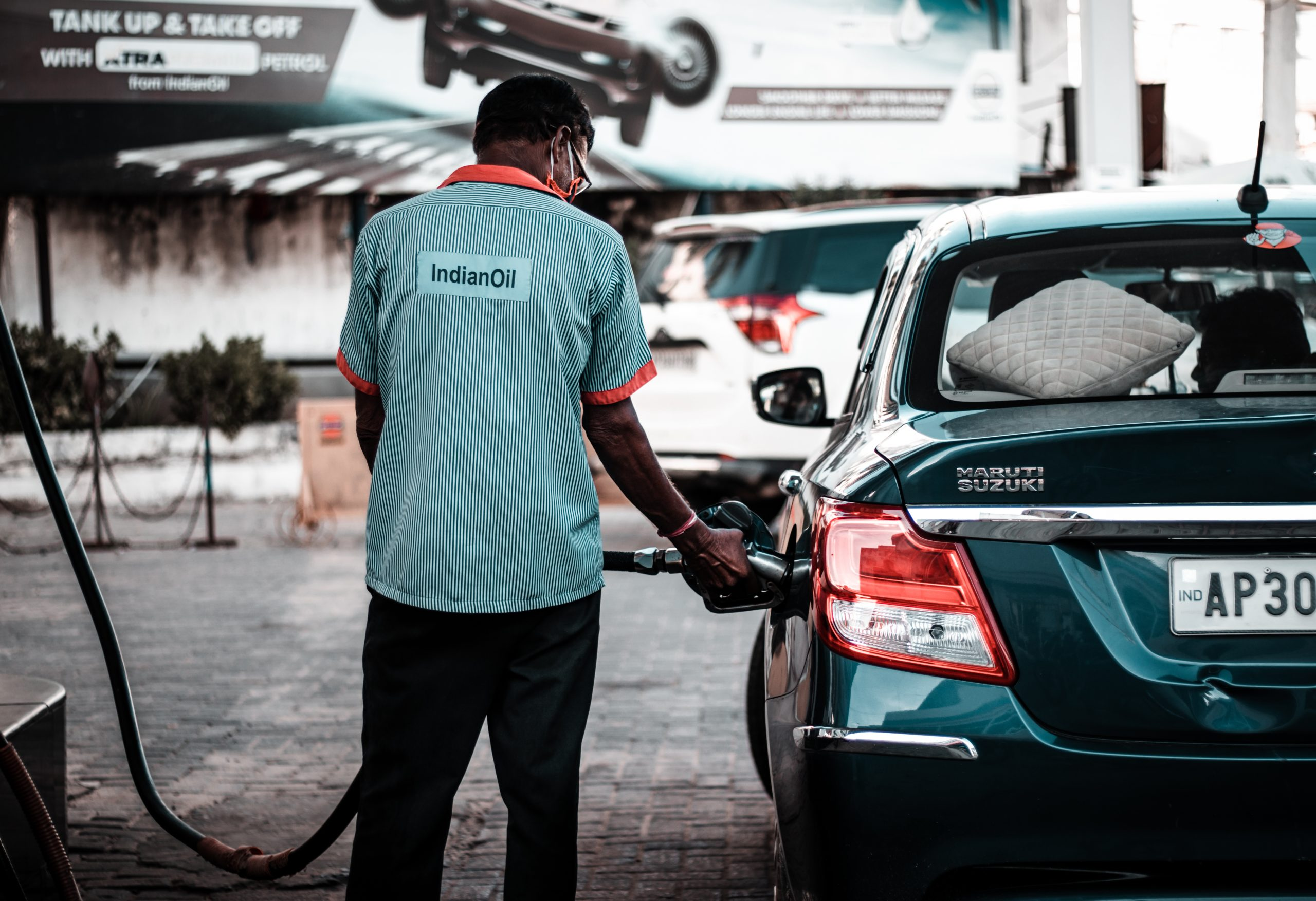 fuel station employee filling the tank