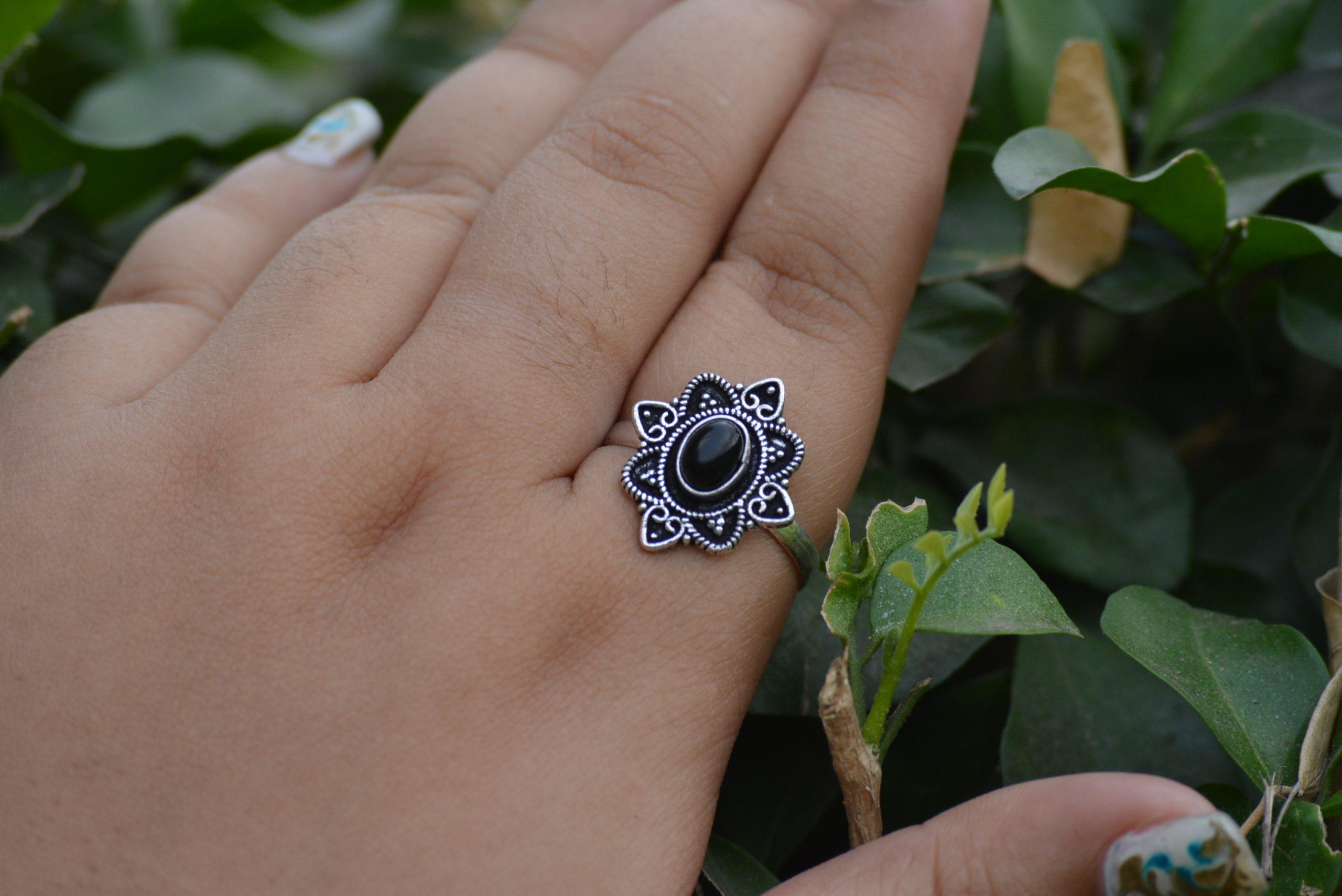black ring on finger