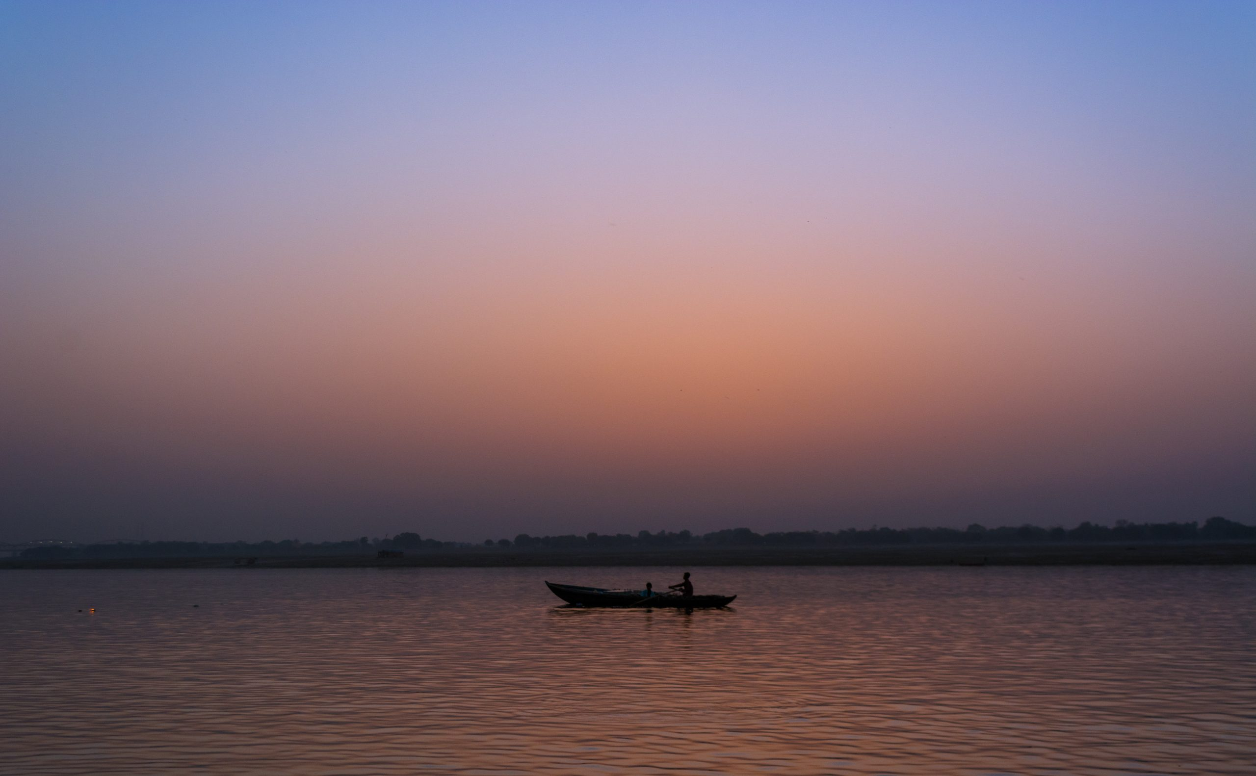 boat in the river at sunrise