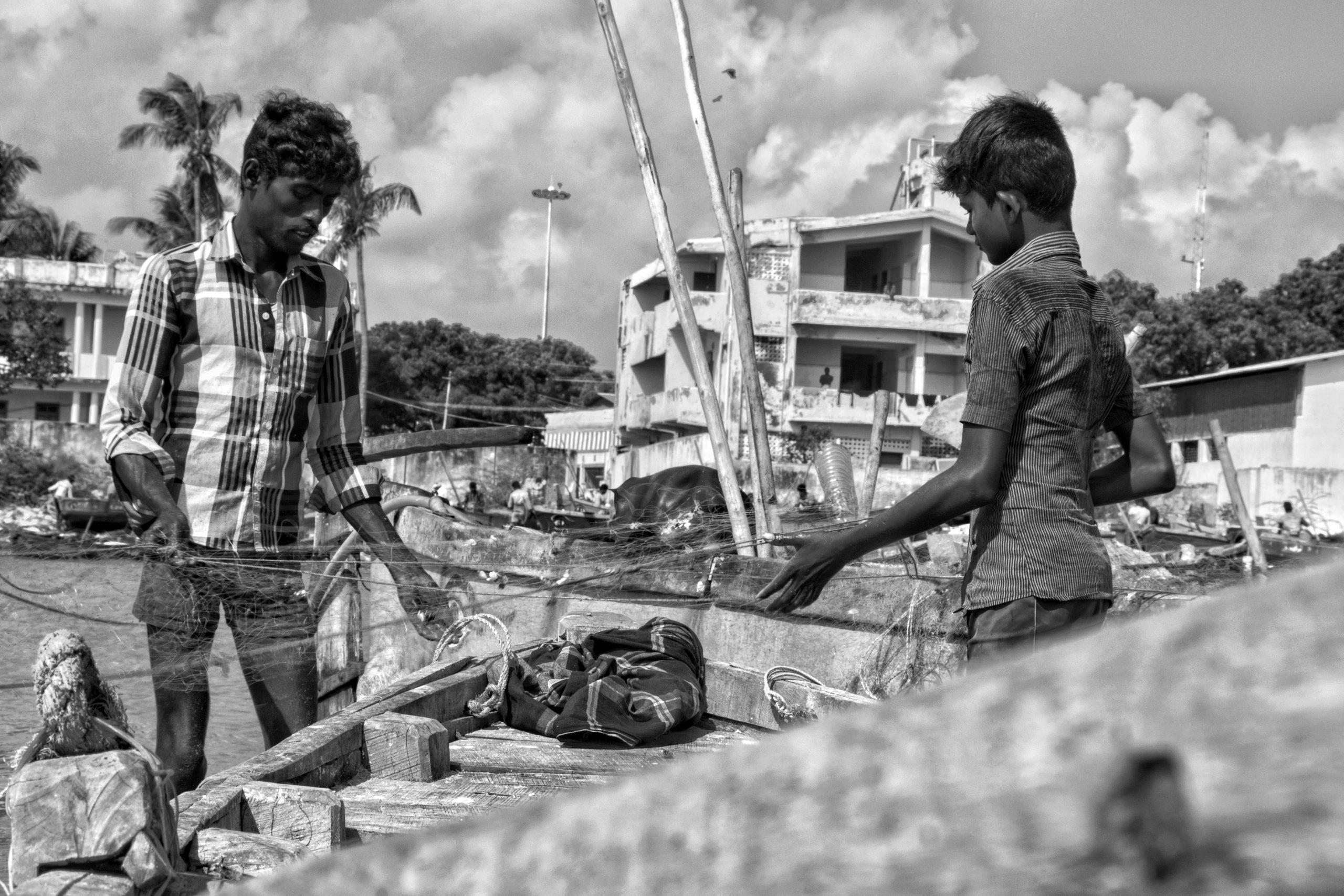 Fishermen arranging fishing net