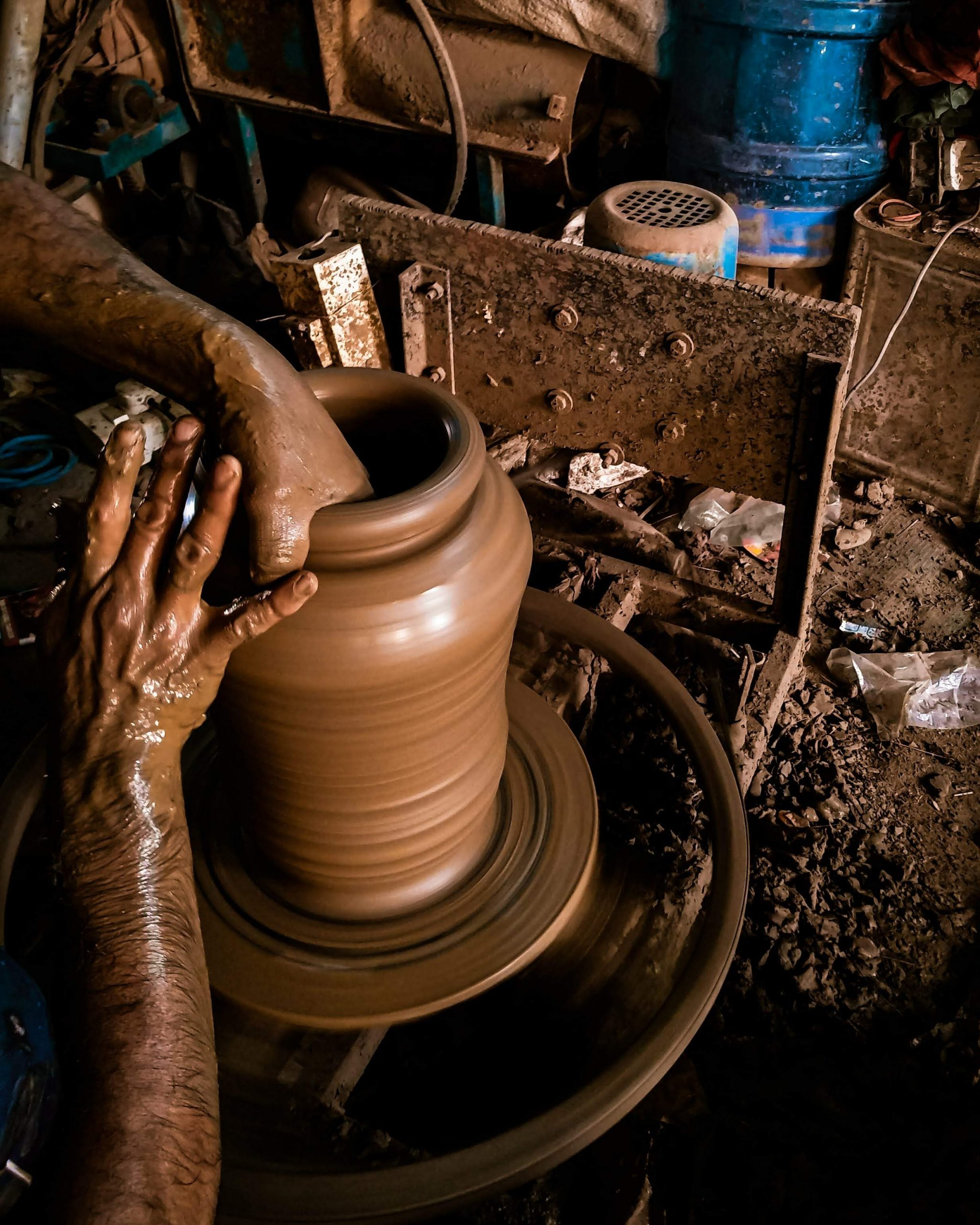 Forming a vessel with clay pottery