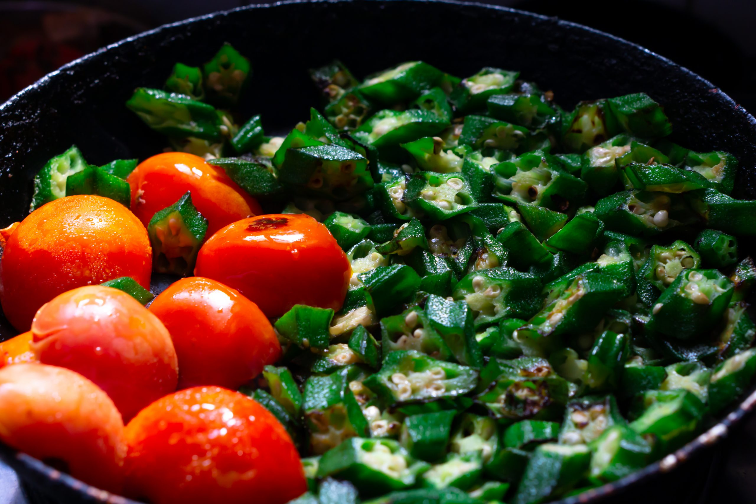 okra and tomatoes in a pan