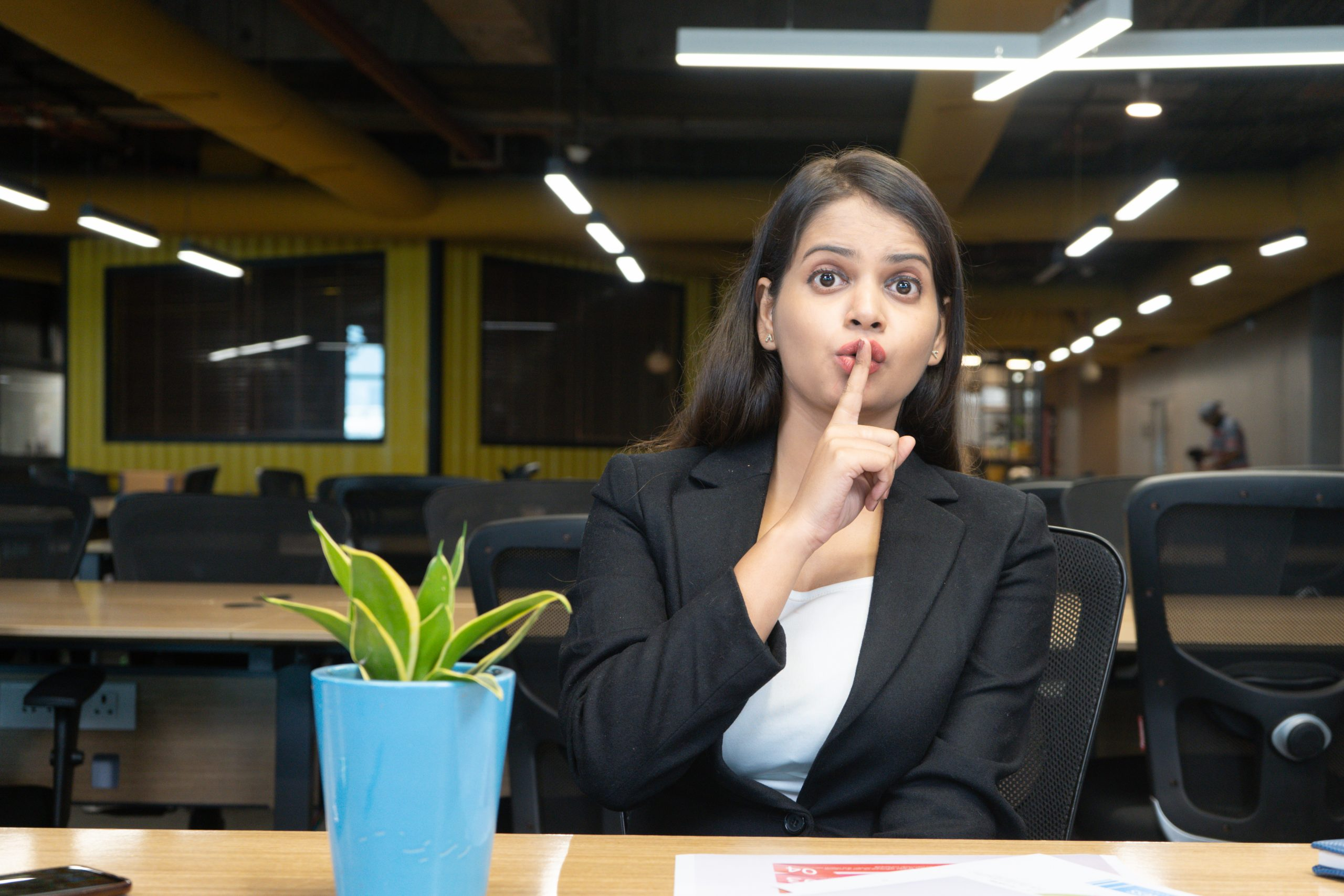 Girl asking to keep quiet in office