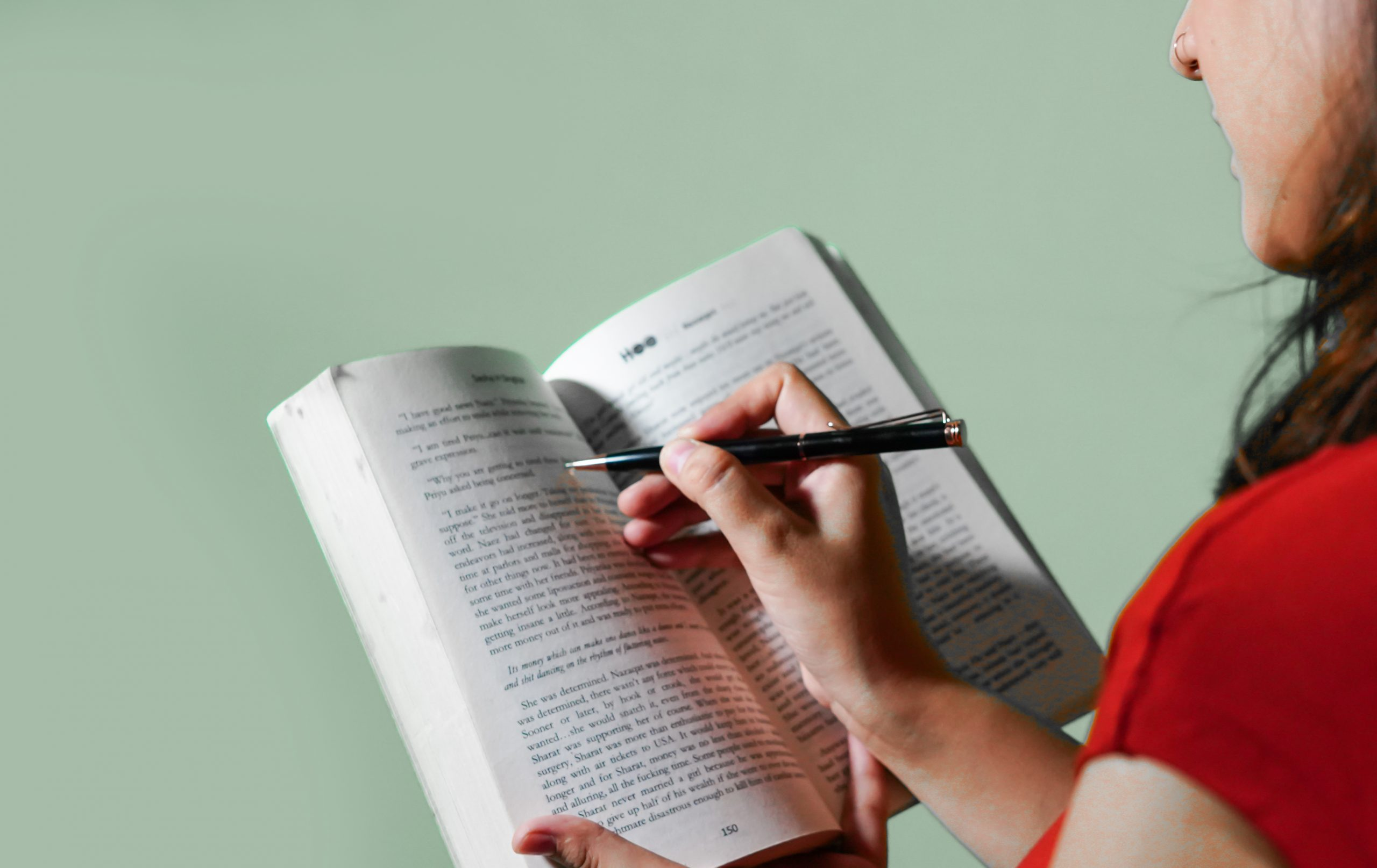 Girl highlighting lines in a book