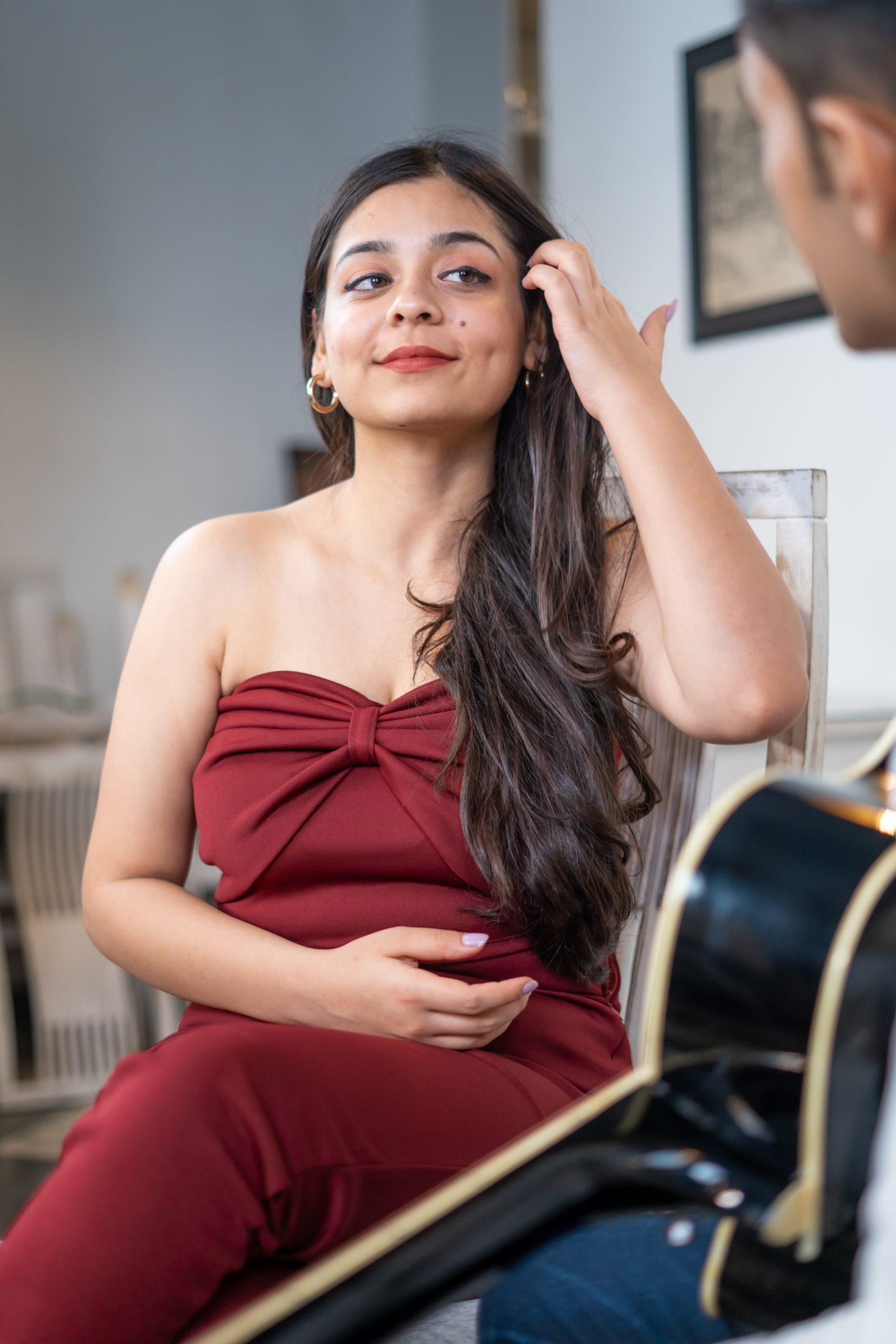 Girl listening to guitar played by boyfriend