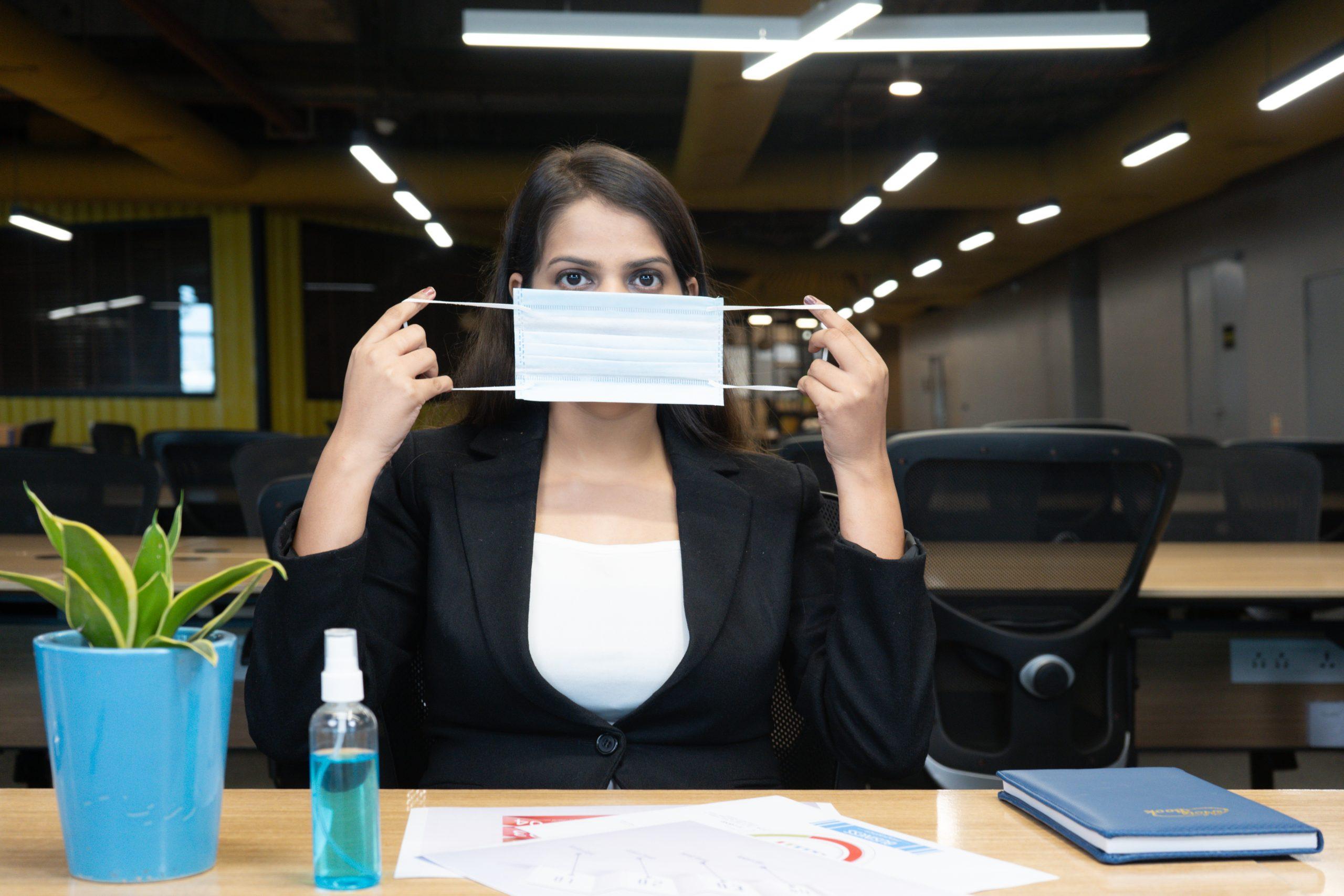 Girl showing mask