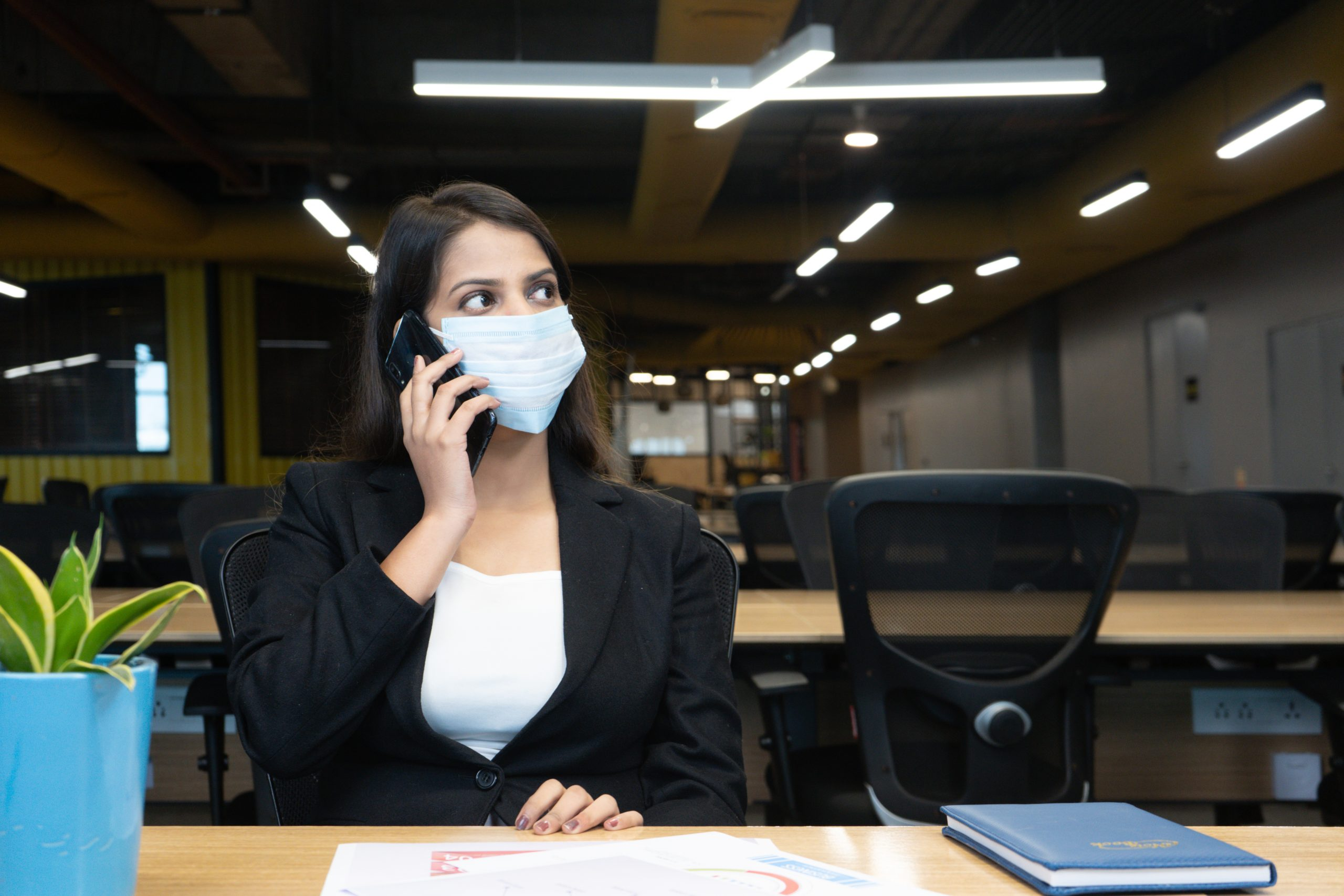 girl with mask talking on phone