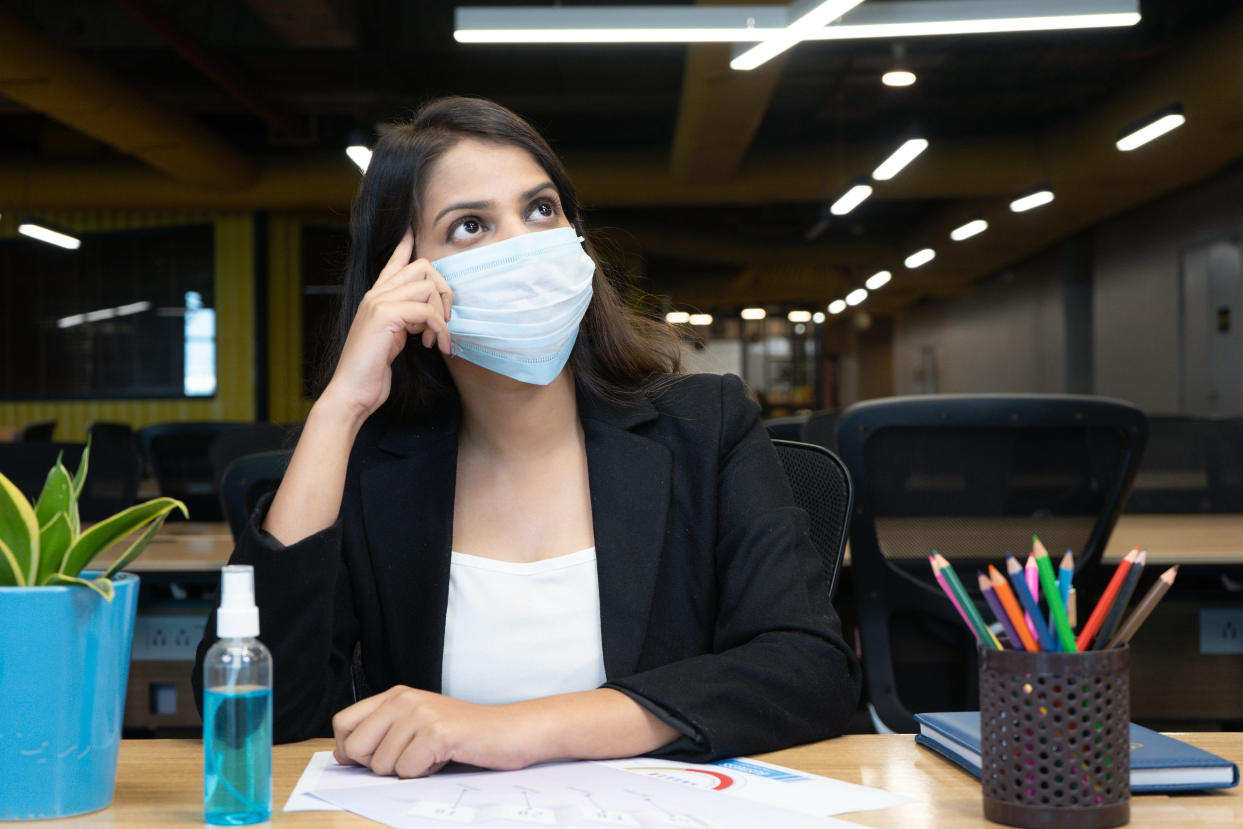 girl with mask in office