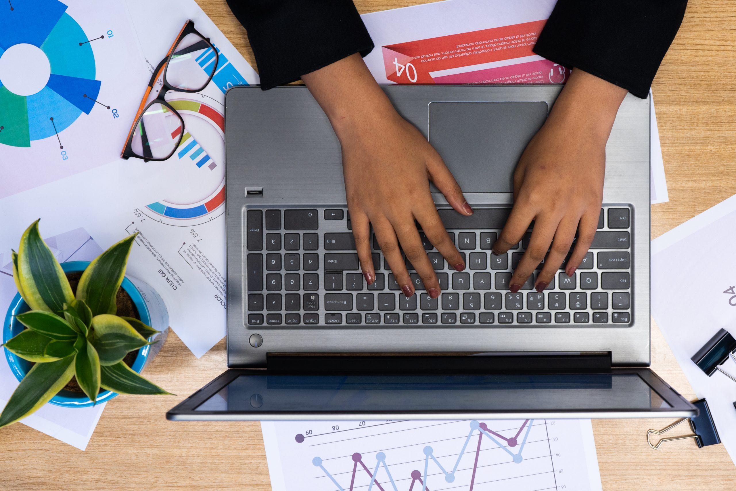 Girl using laptop topview