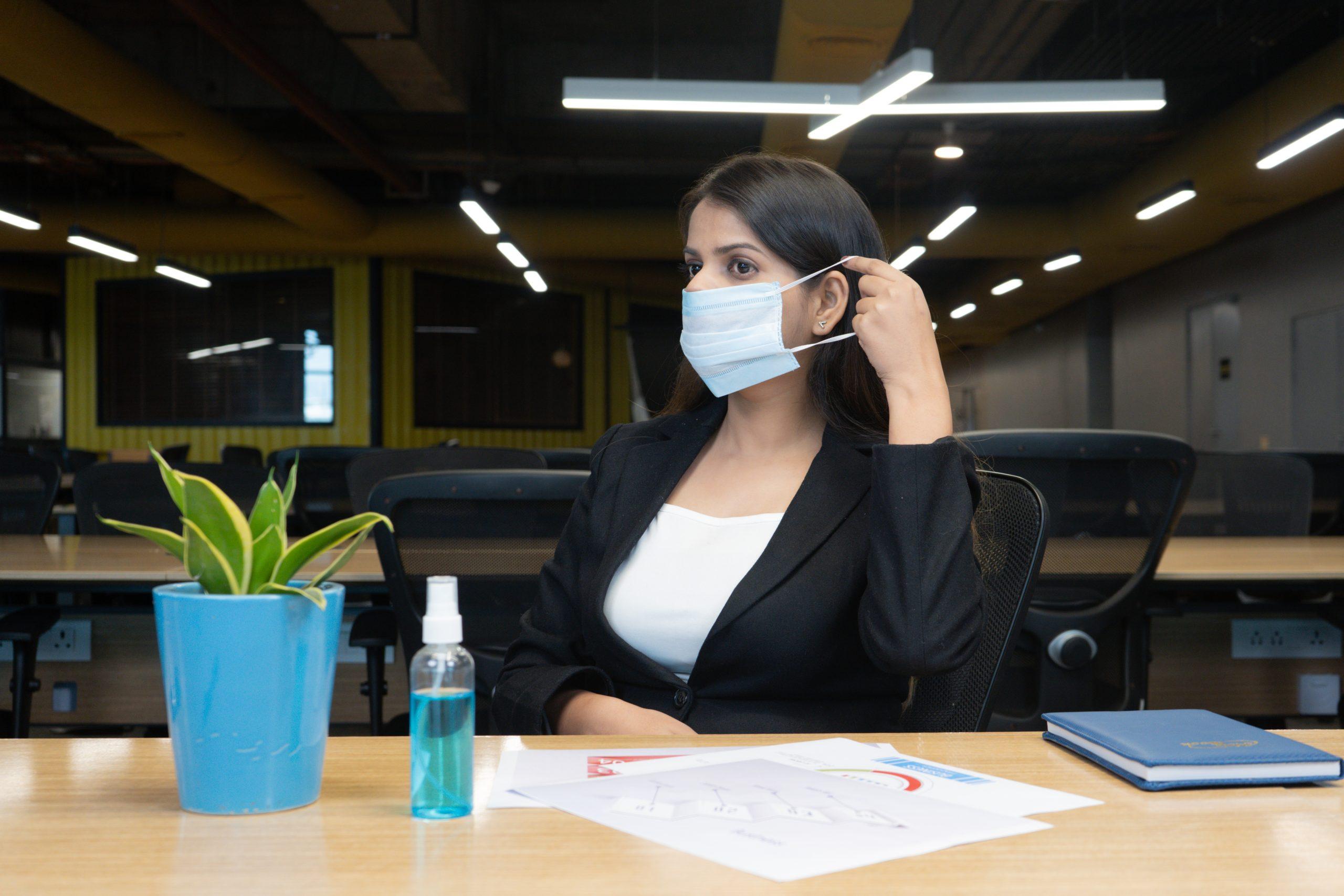 Girl wearing mask in office