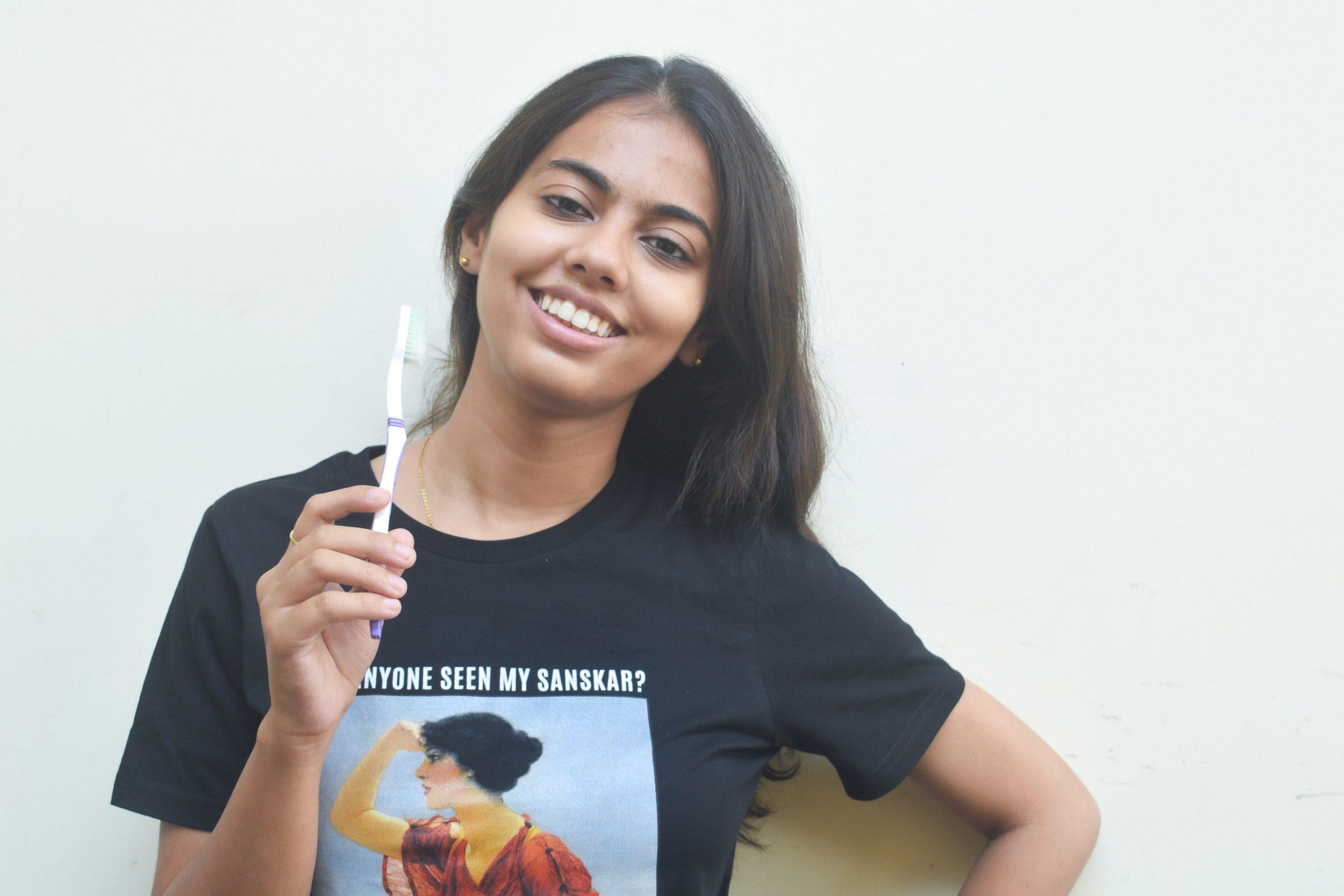 girl holding toothbrush