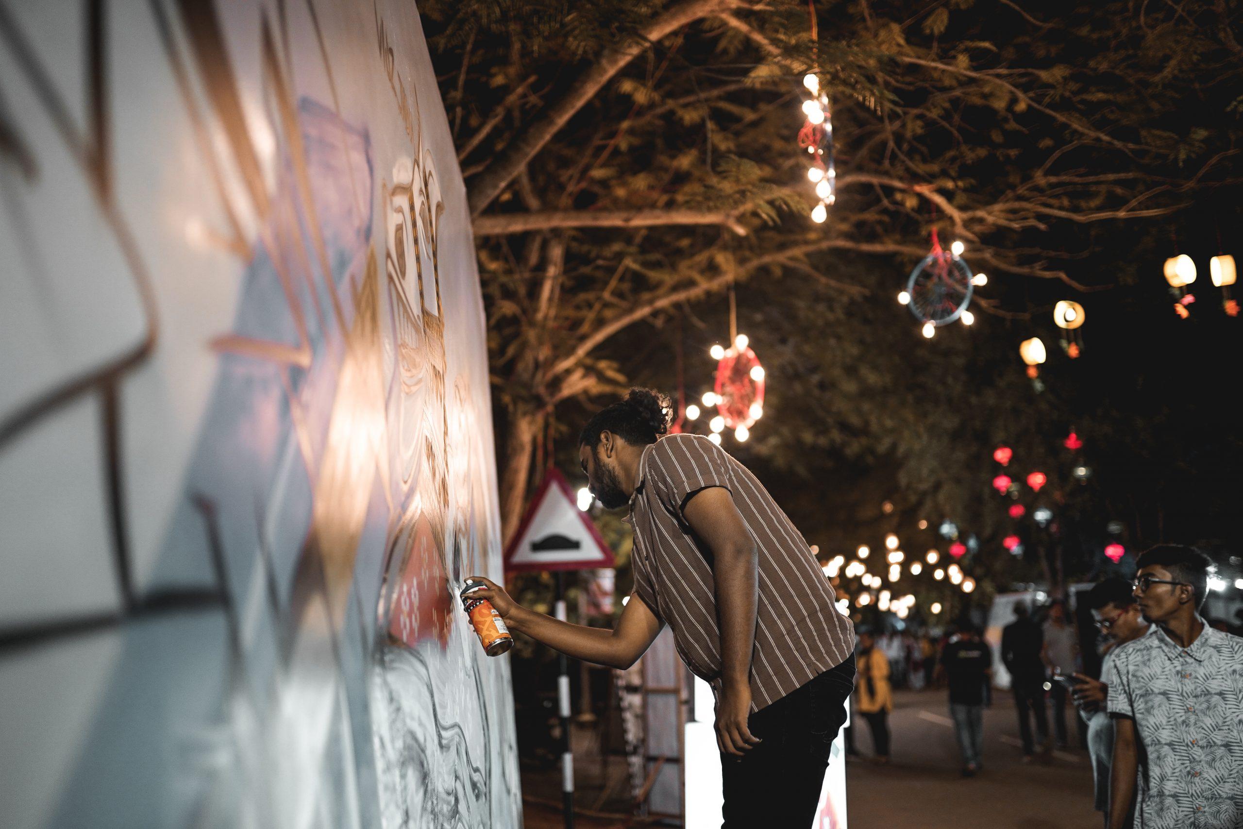 man making graffiti