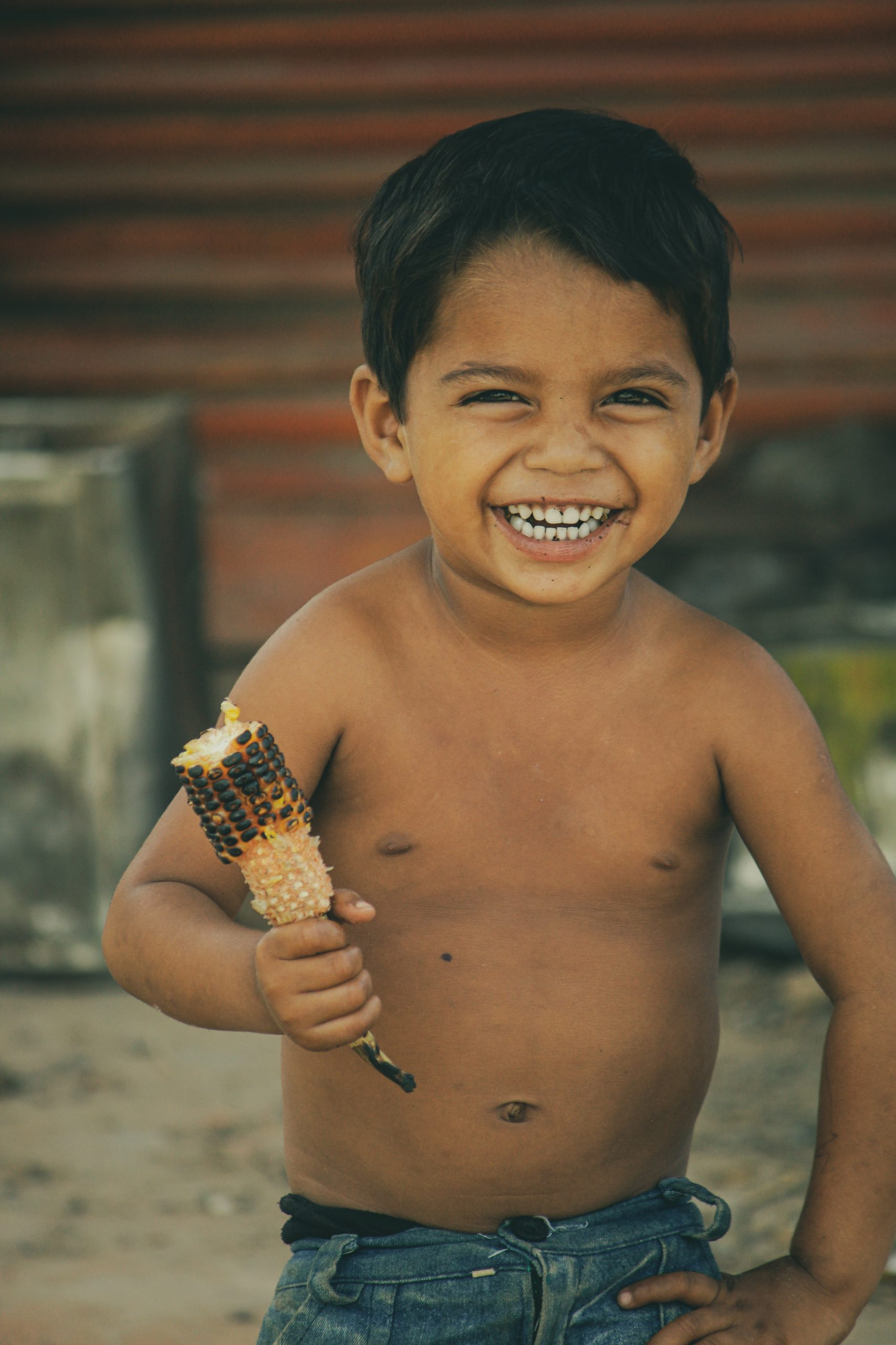 Kid eating corn cob