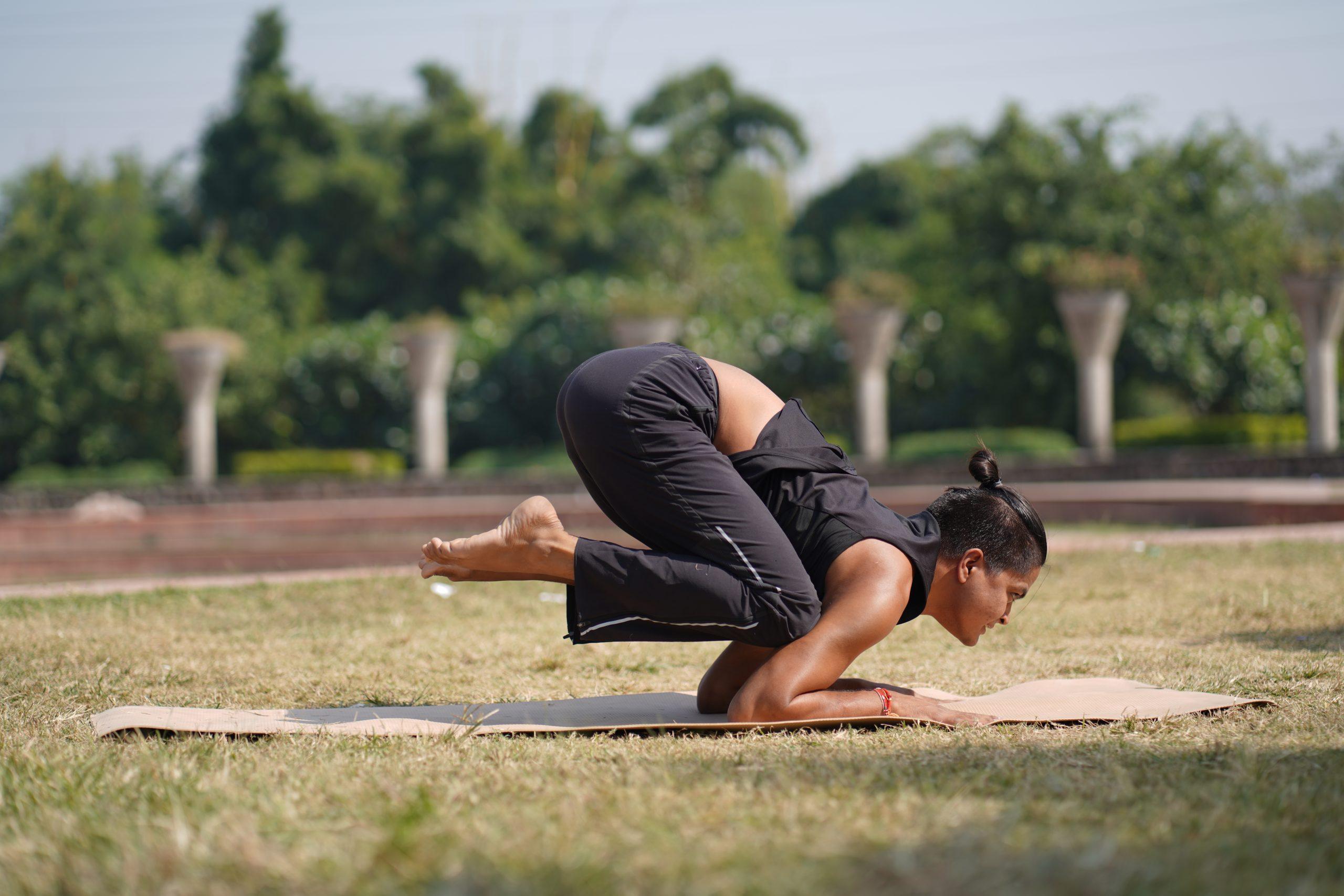 girl doing yoga in garden