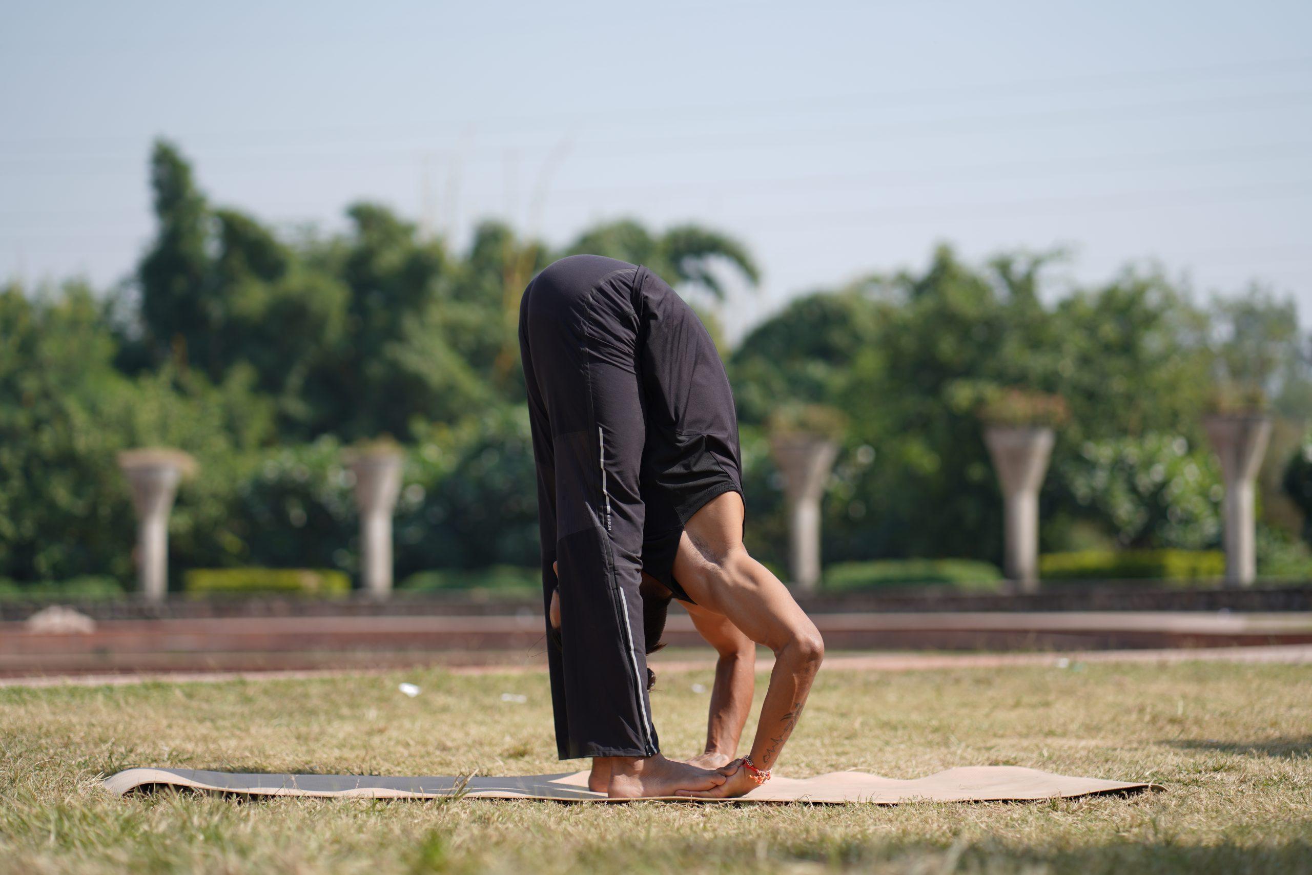 man doing yoga in garden