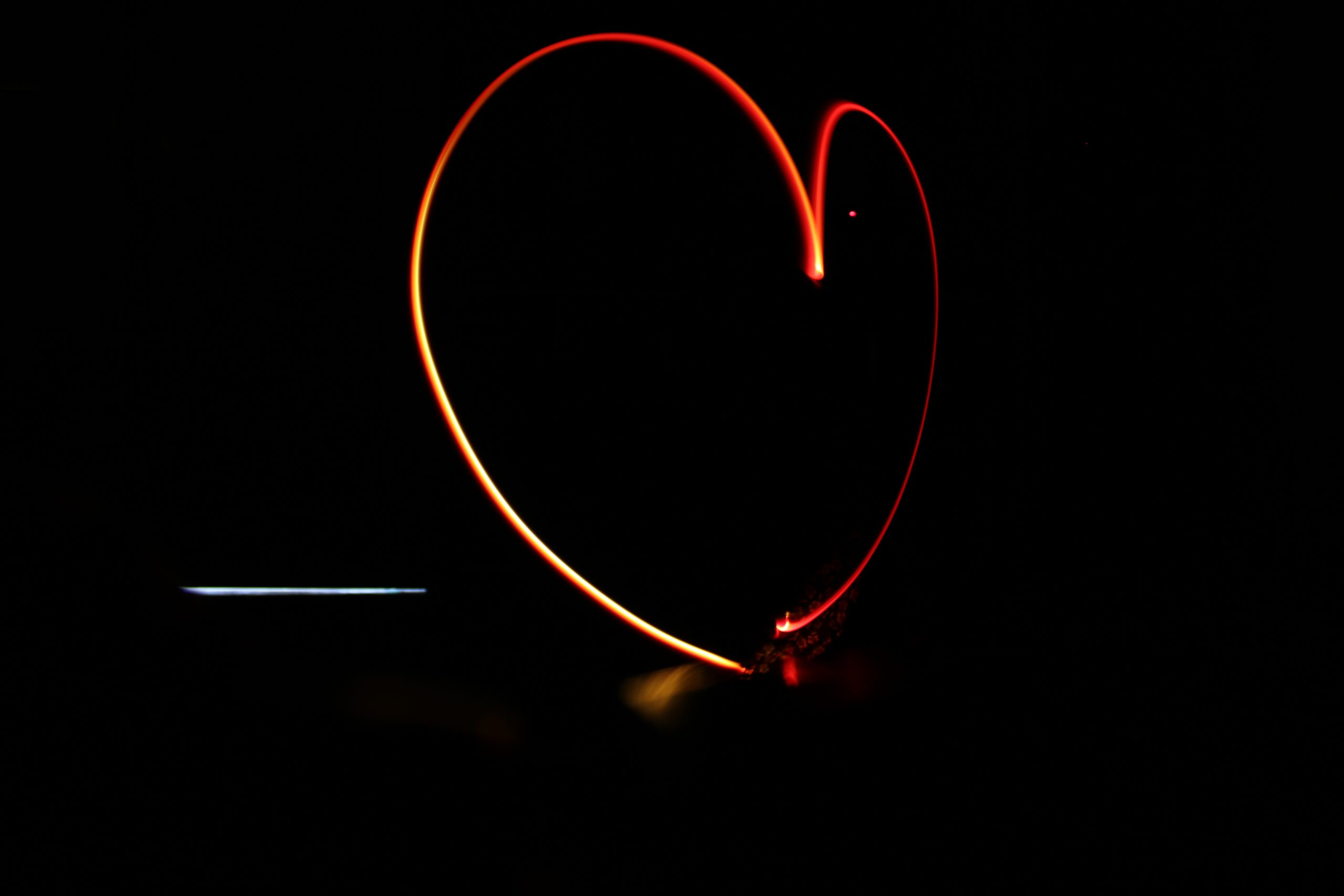 Heart shape formed with light trails